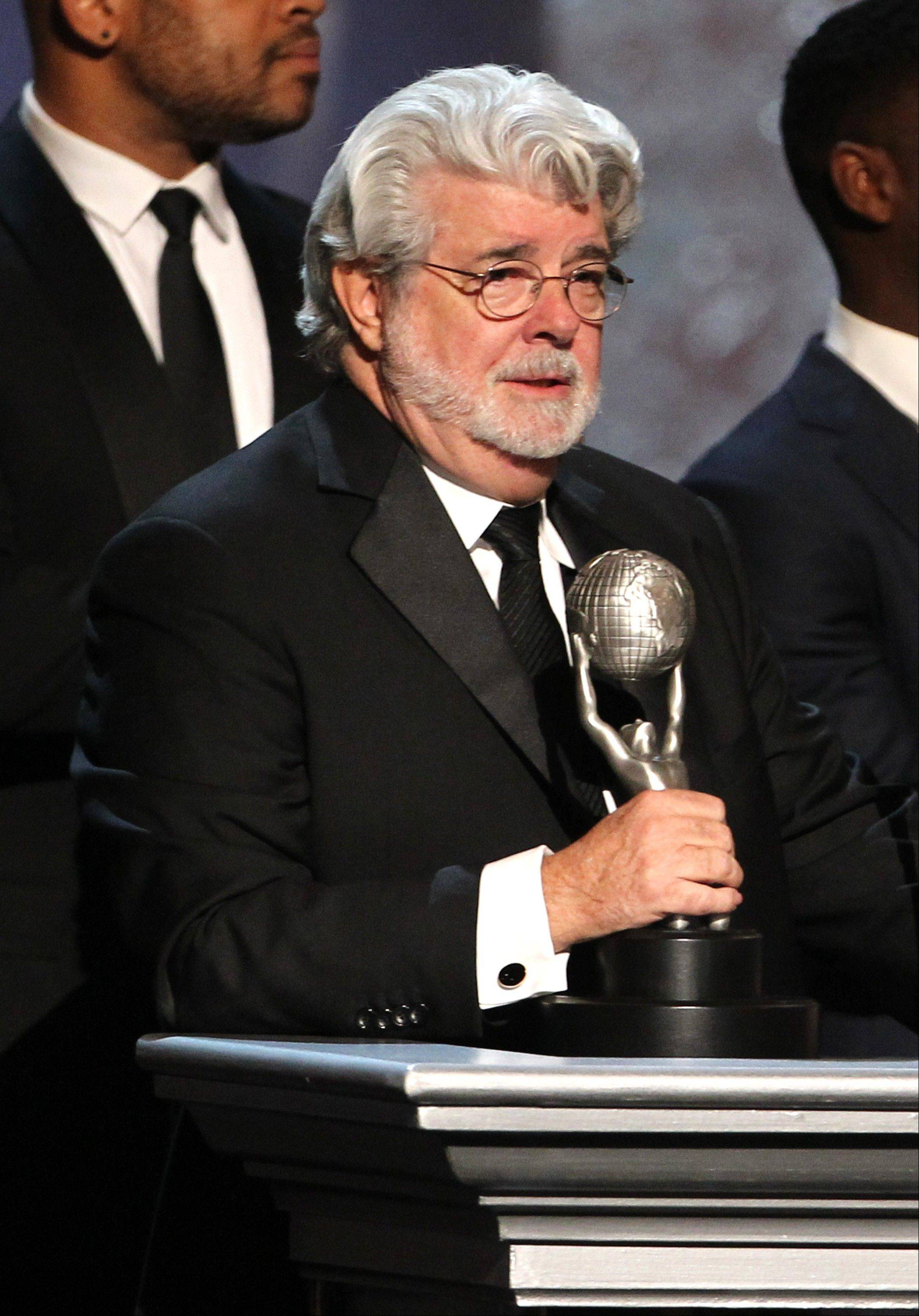 "George Lucas accepts the award for outstanding motion picture for ""Red Tails"" at the 44th Annual NAACP Image Awards at the Shrine Auditorium in Los Angeles on Friday, Feb. 1, 2013."