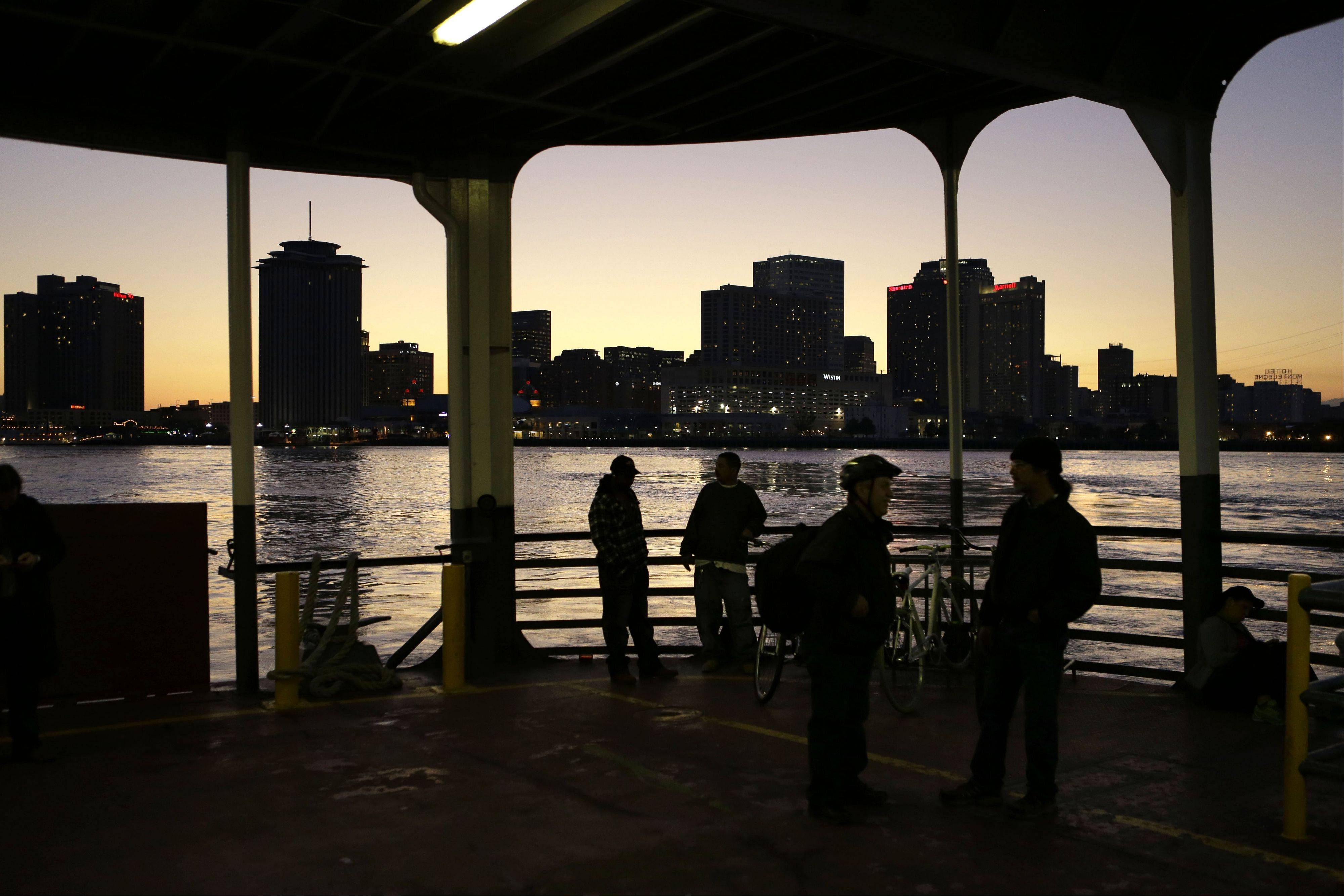 People ride the ferryboat across the Mississippi from downtown New Orleans.