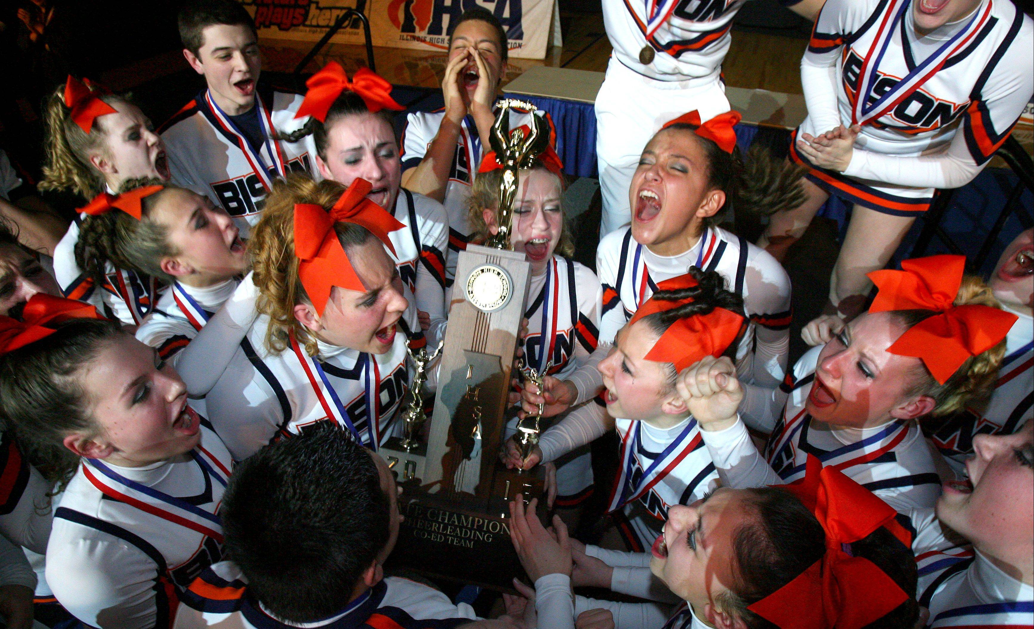 Buffalo Grove High School's large coed team celebrate after winning first place in the IHSA Competitive Cheerleading finals on Saturday at the U.S. Cellular Coliseum in Bloomington.