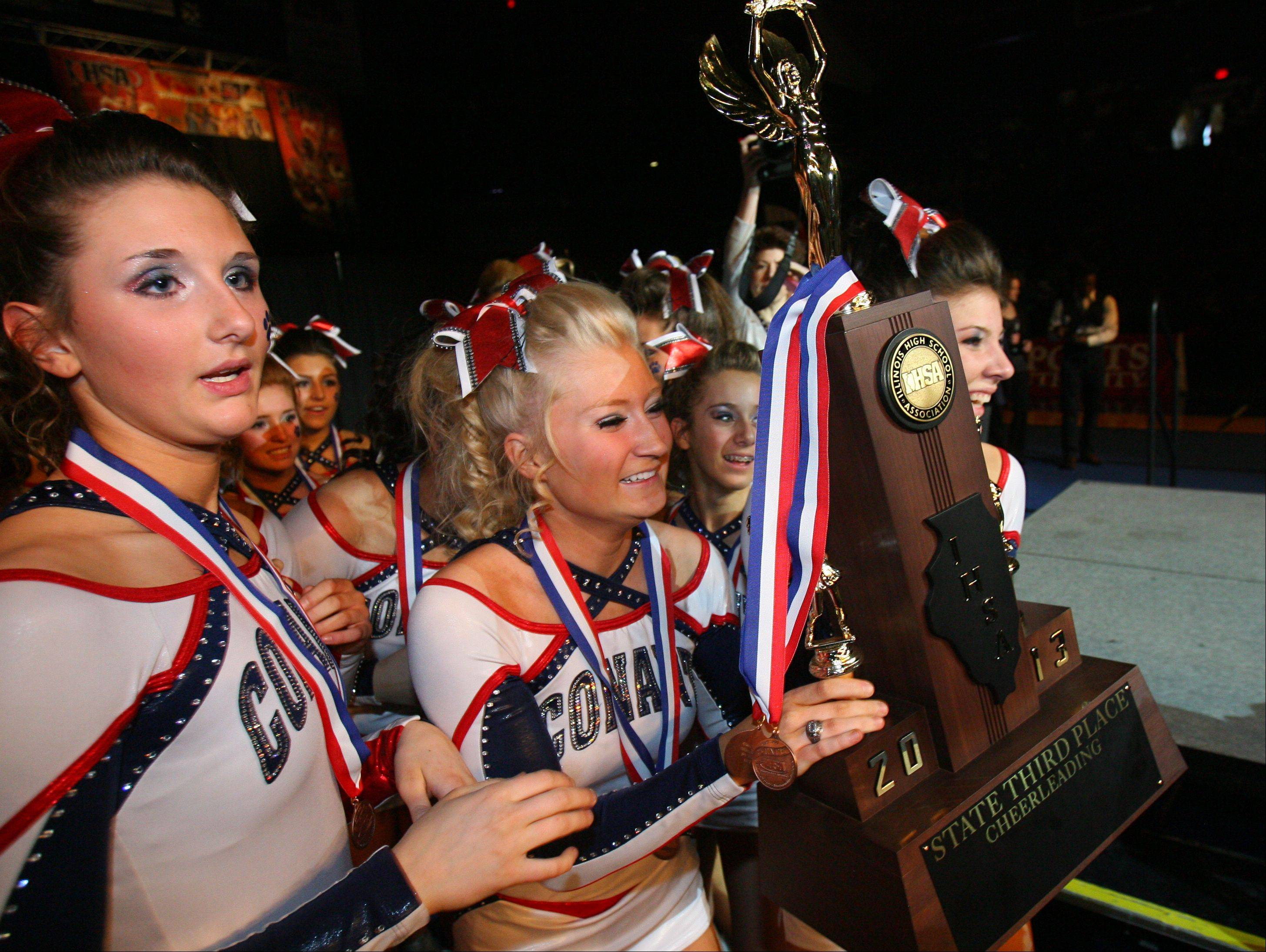 Steve Lundy/slundy@dailyherald.comGirls from Conant High School celebrate after winning third place in the IHSA Competitive Cheerleading finals on Saturday at the U.S. Cellular Coliseum in Bloomington.