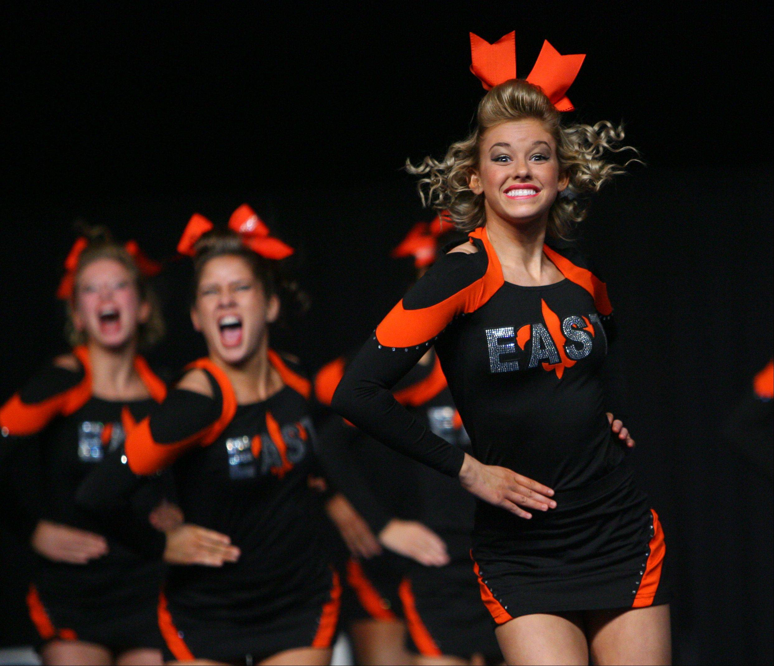 St. Charles East High School competes in the IHSA Competitive Cheerleading finals on Saturday at the U.S. Cellular Coliseum in Bloomington.