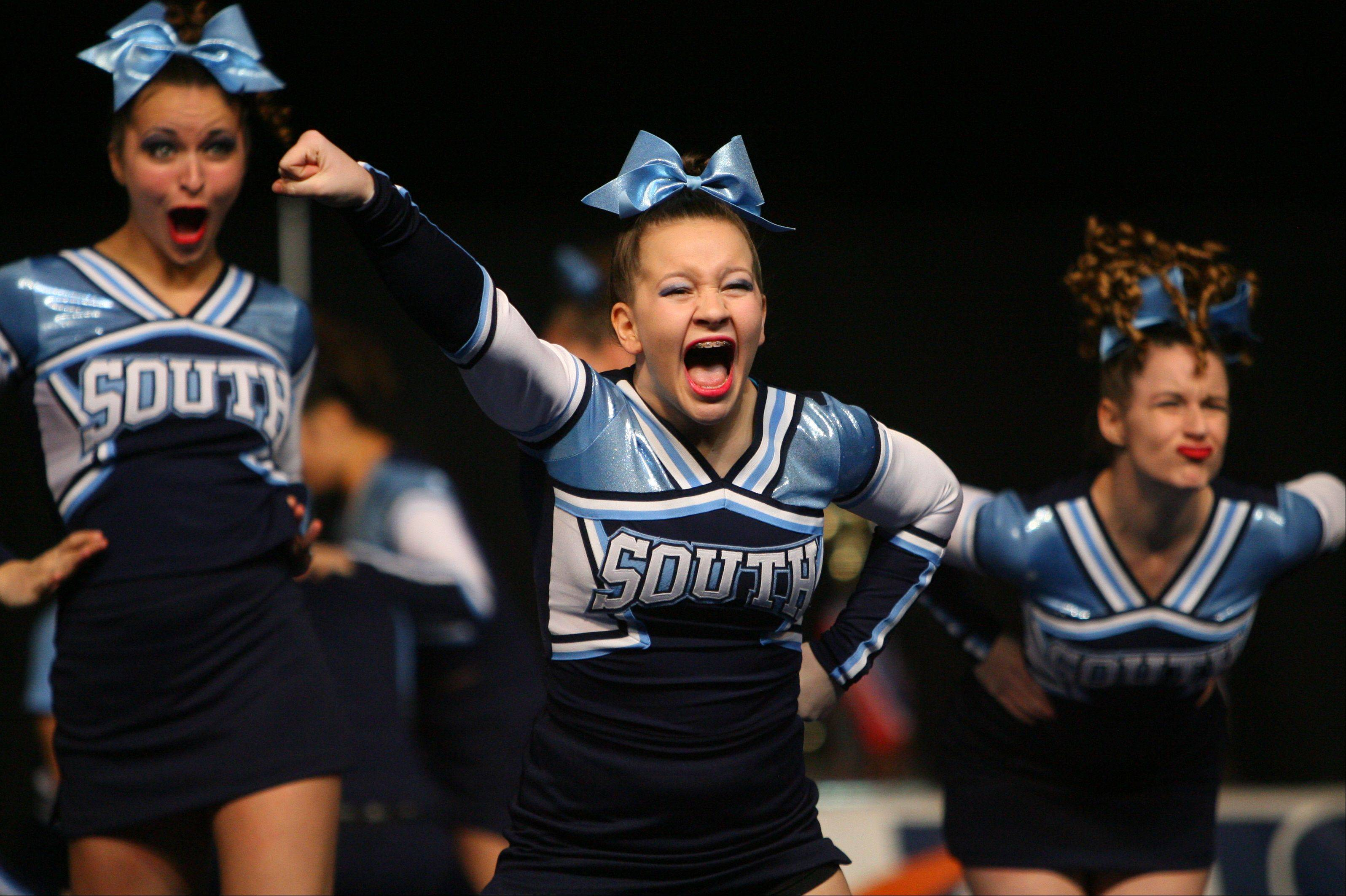 Downers Grove South High School competes in the IHSA Competitive Cheerleading finals on Saturday at the U.S. Cellular Coliseum in Bloomington.