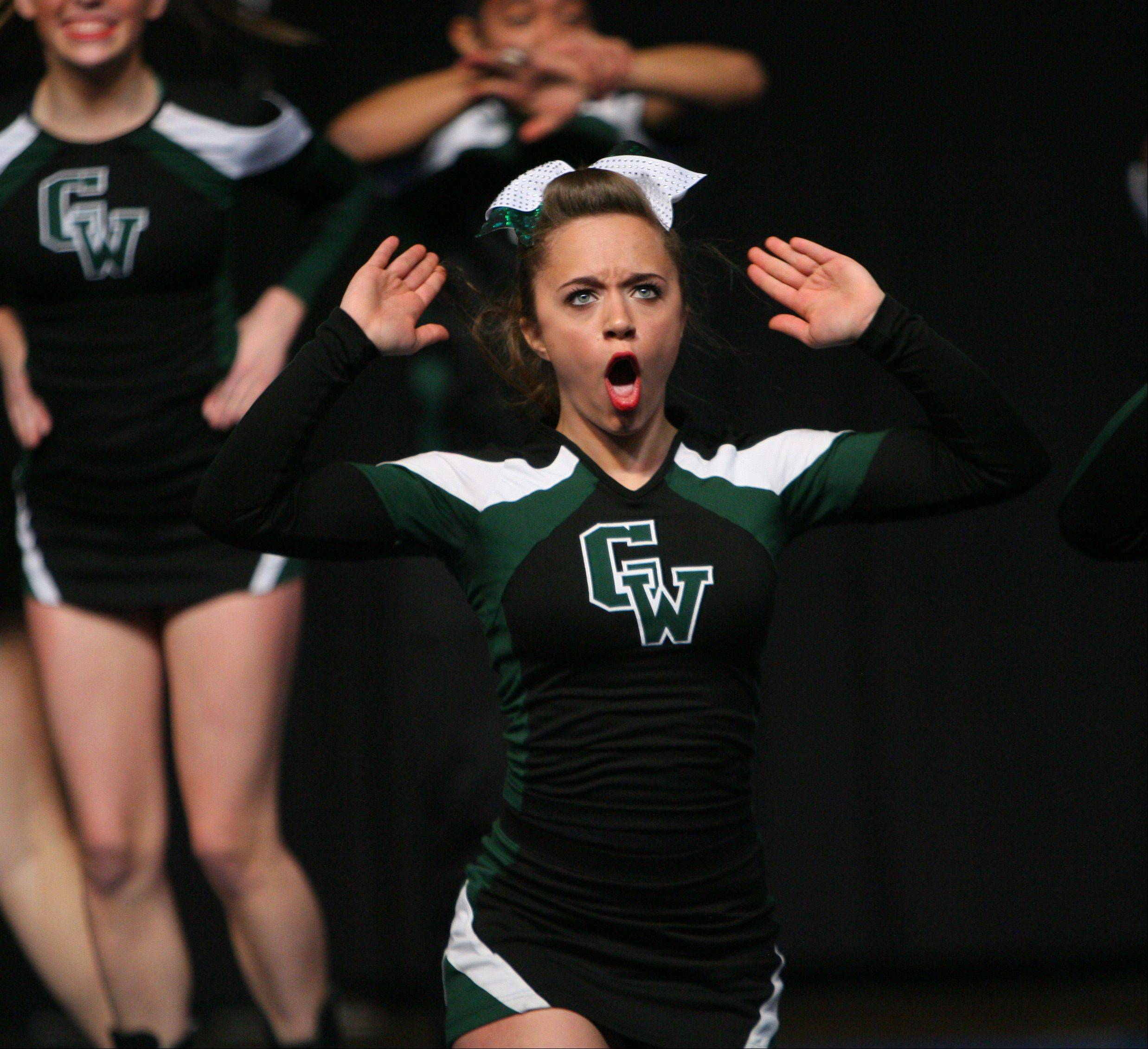 Glenbard West High School competes in the IHSA Competitive Cheerleading finals on Saturday at the U.S. Cellular Coliseum in Bloomington.