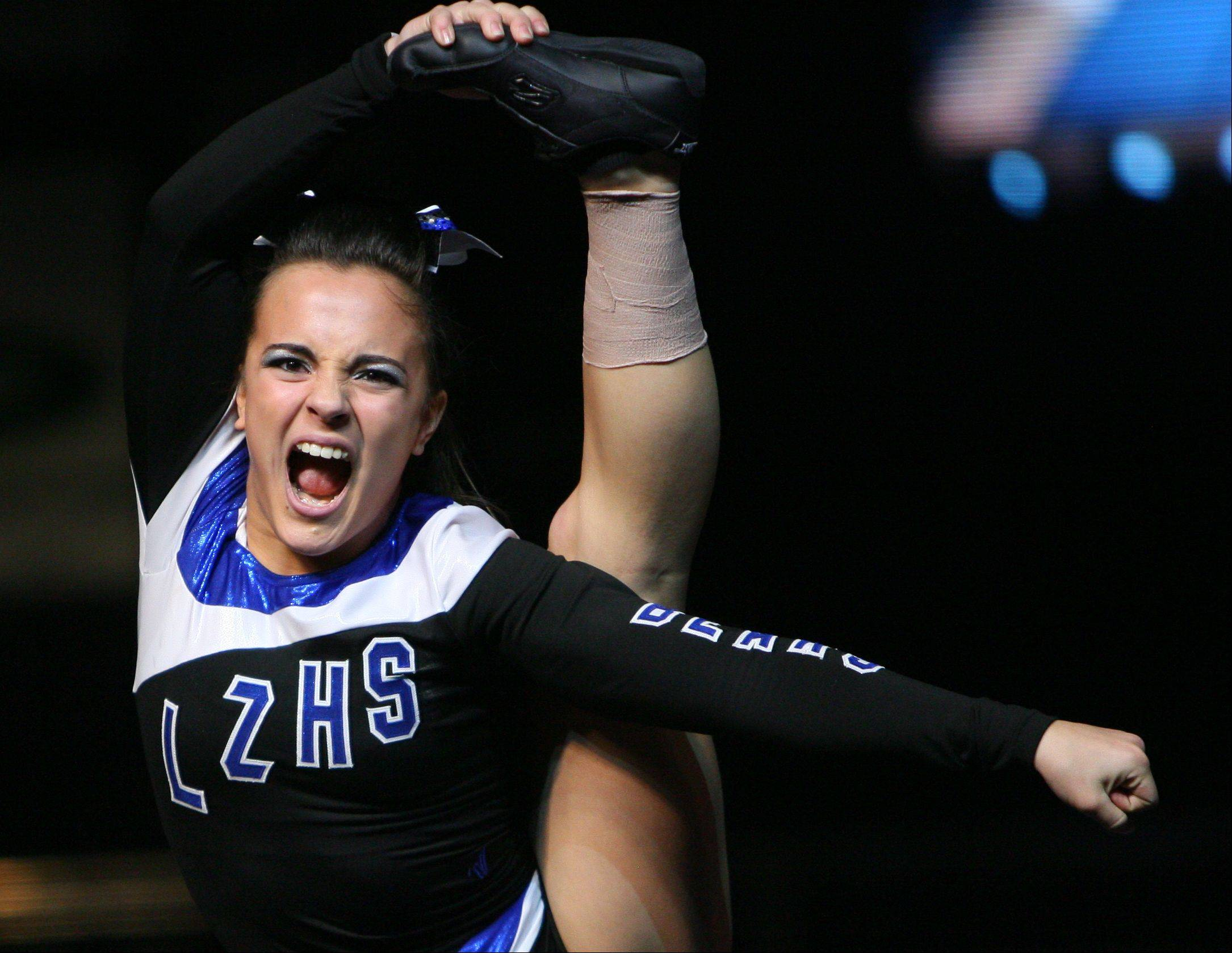 Lake Zurich High School participates in the IHSA Competitive Cheerleading finals on Saturday at the U.S. Cellular Coliseum in Bloomington.