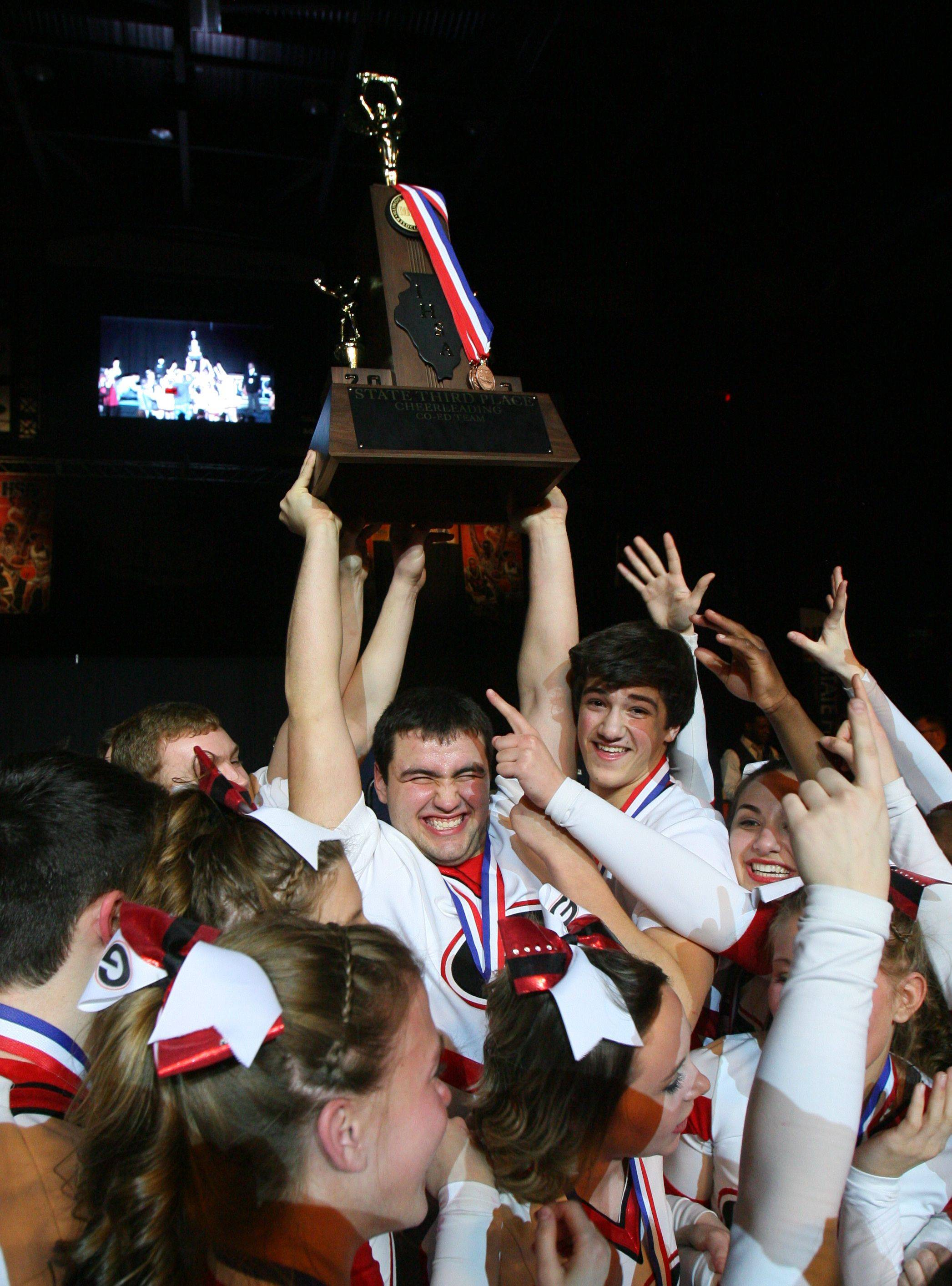 Grant High School's large coed team celebrates after winning third place in the IHSA Competitive Cheerleading finals on Saturday at the U.S. Cellular Coliseum in Bloomington.