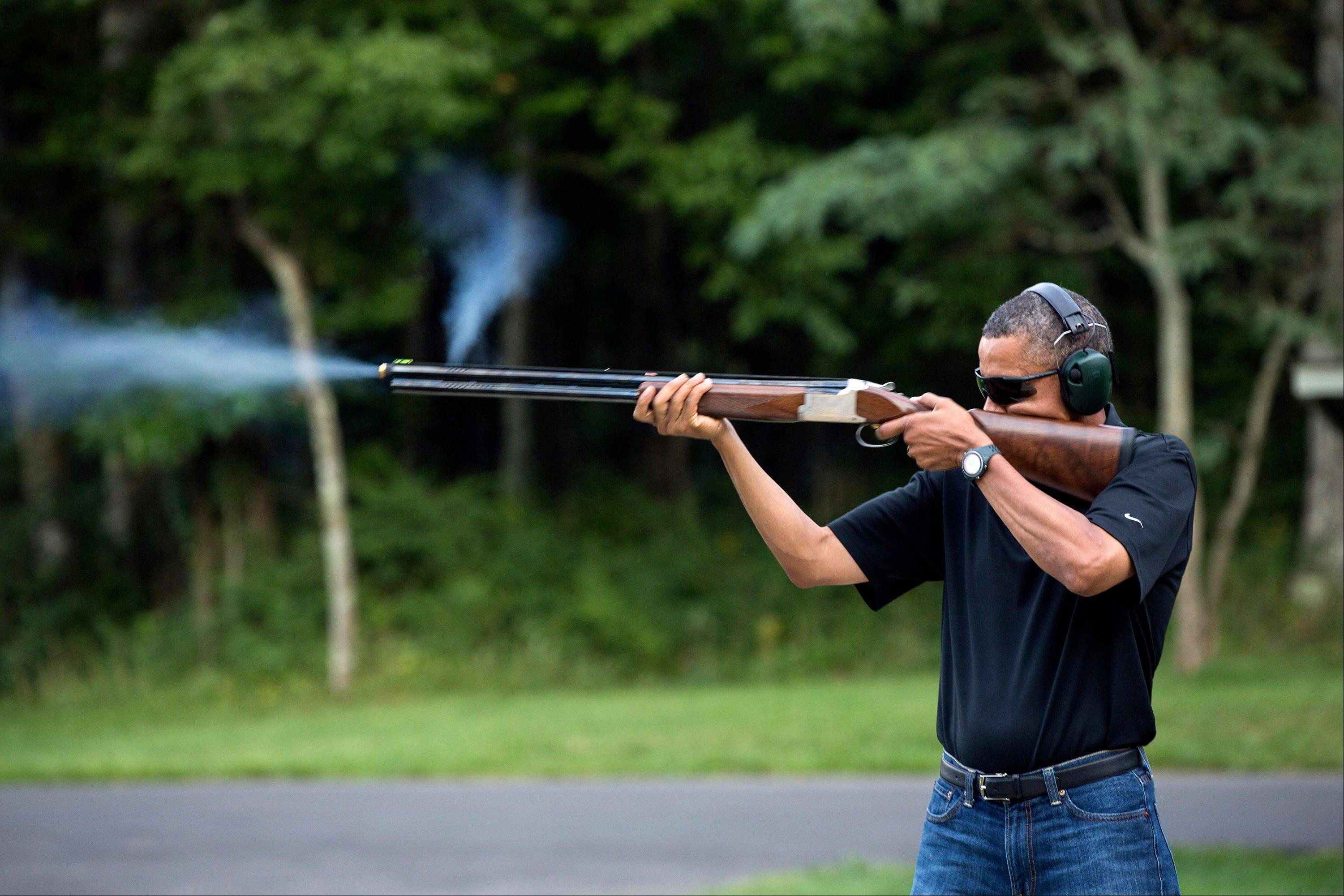 President Barack Obama shoots clay targets on the range at Camp David, Md.