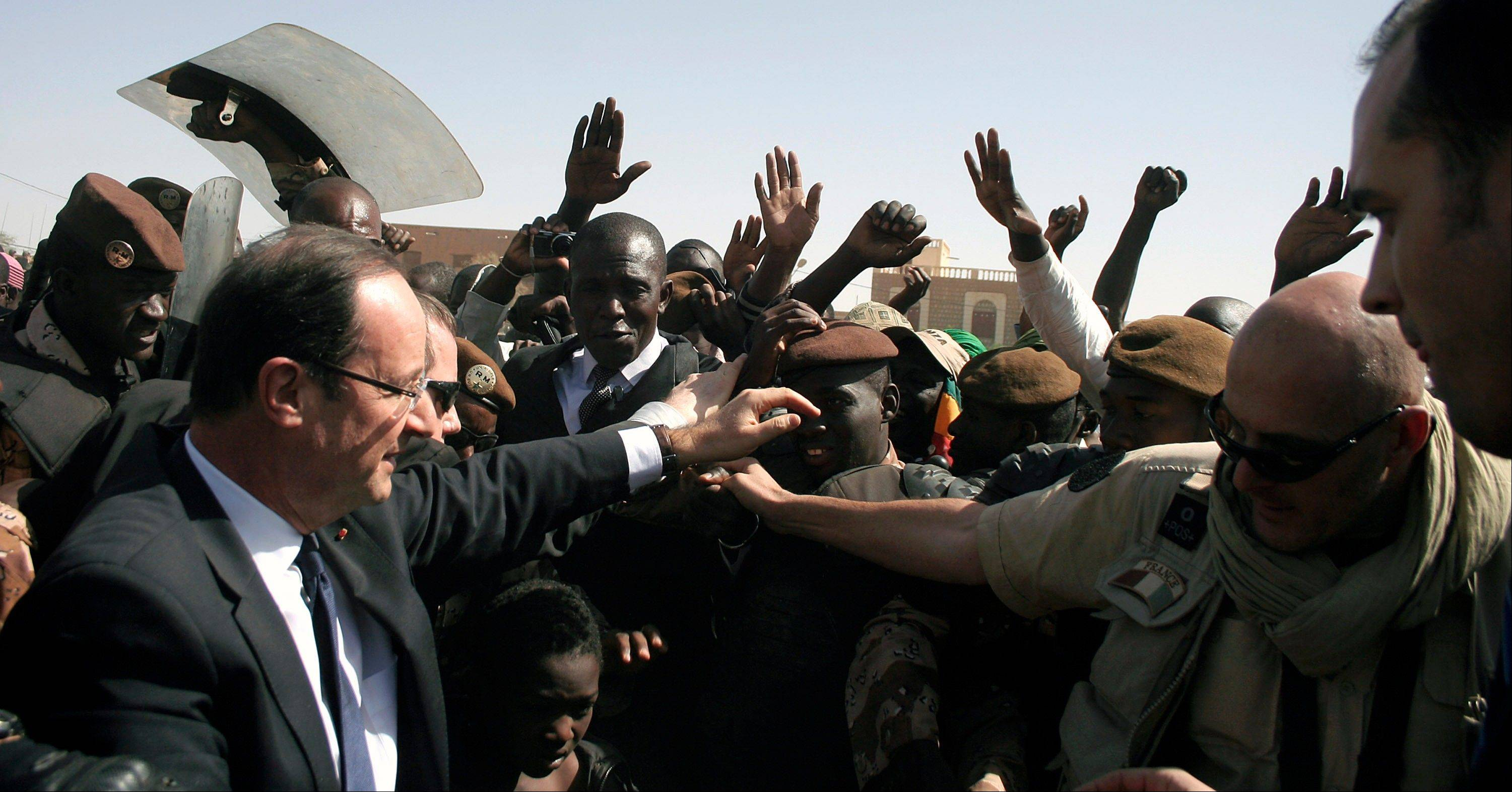 French President Francois Hollande visits Timbuktu, Mali, on Saturday.