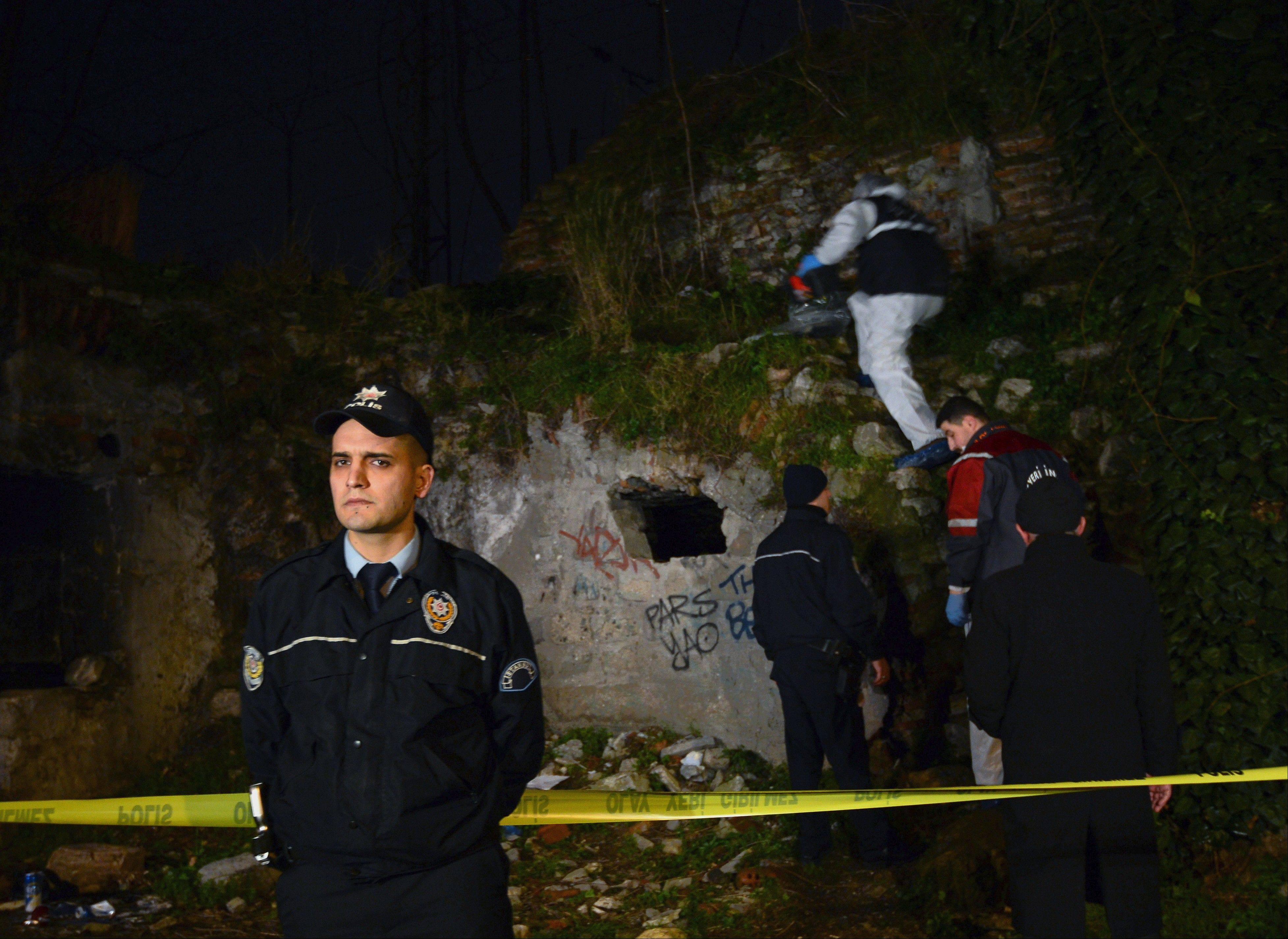 A police forensics team searches for missing New York City woman Sarai Sierra near the remnants of some ancient city walls in low-income district of Sarayburnu in Istanbul, Turkey, late Saturday. Turkey's state-run news agency said that she has been found dead in Istanbul.