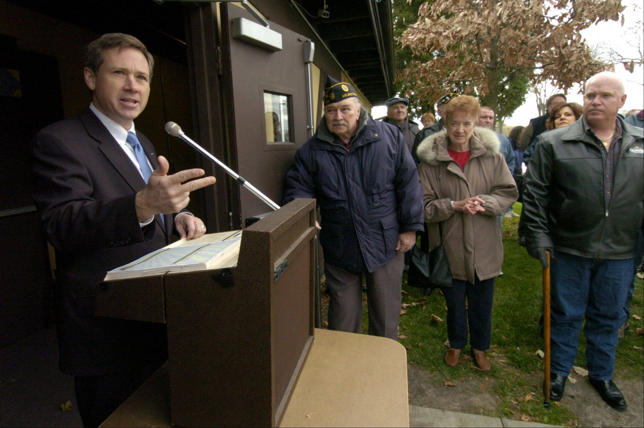 Congressman Mark Kirk addresses a Veterans Day gathering in Arlington Heights during healthier times back in 2004.
