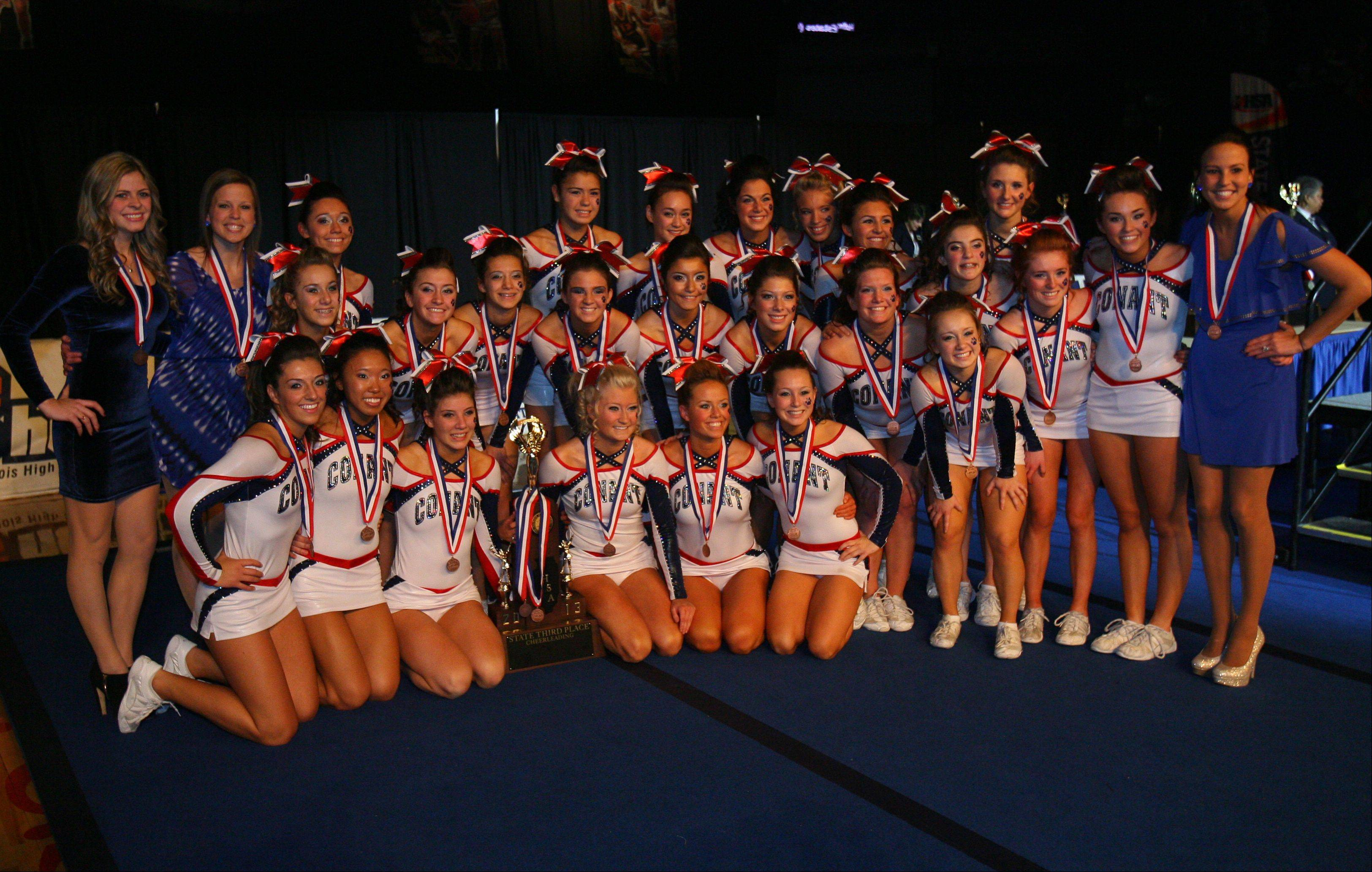 Girls from Conant High School celebrate after winning 3rd place in the IHSA Competitive Cheerleading finals on Saturday, Feb. 2 at the U.S. Cellular Coliseum in Bloomington.