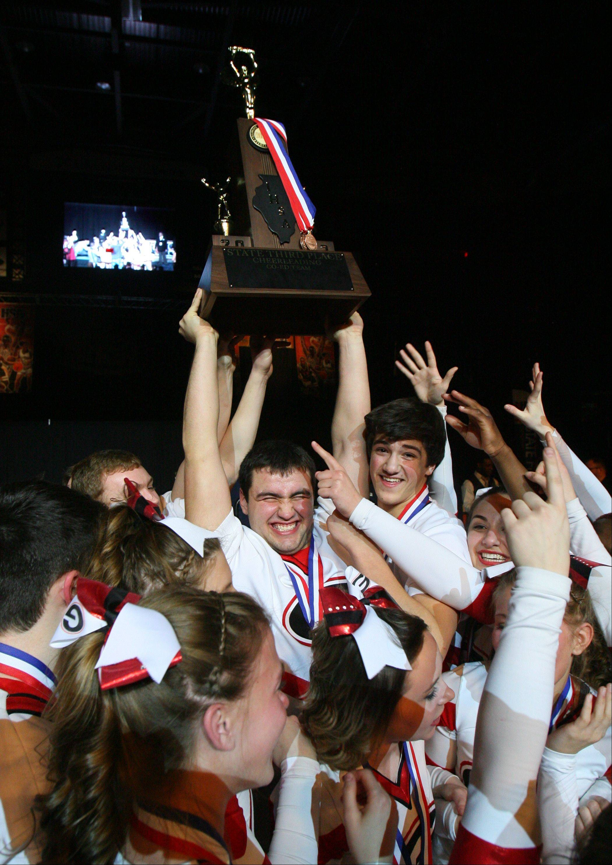Grant High School's large co-ed team celebrate after winning 3rd place in the IHSA Competitive Cheerleading finals on Saturday, Feb. 2 at the U.S. Cellular Coliseum in Bloomington.