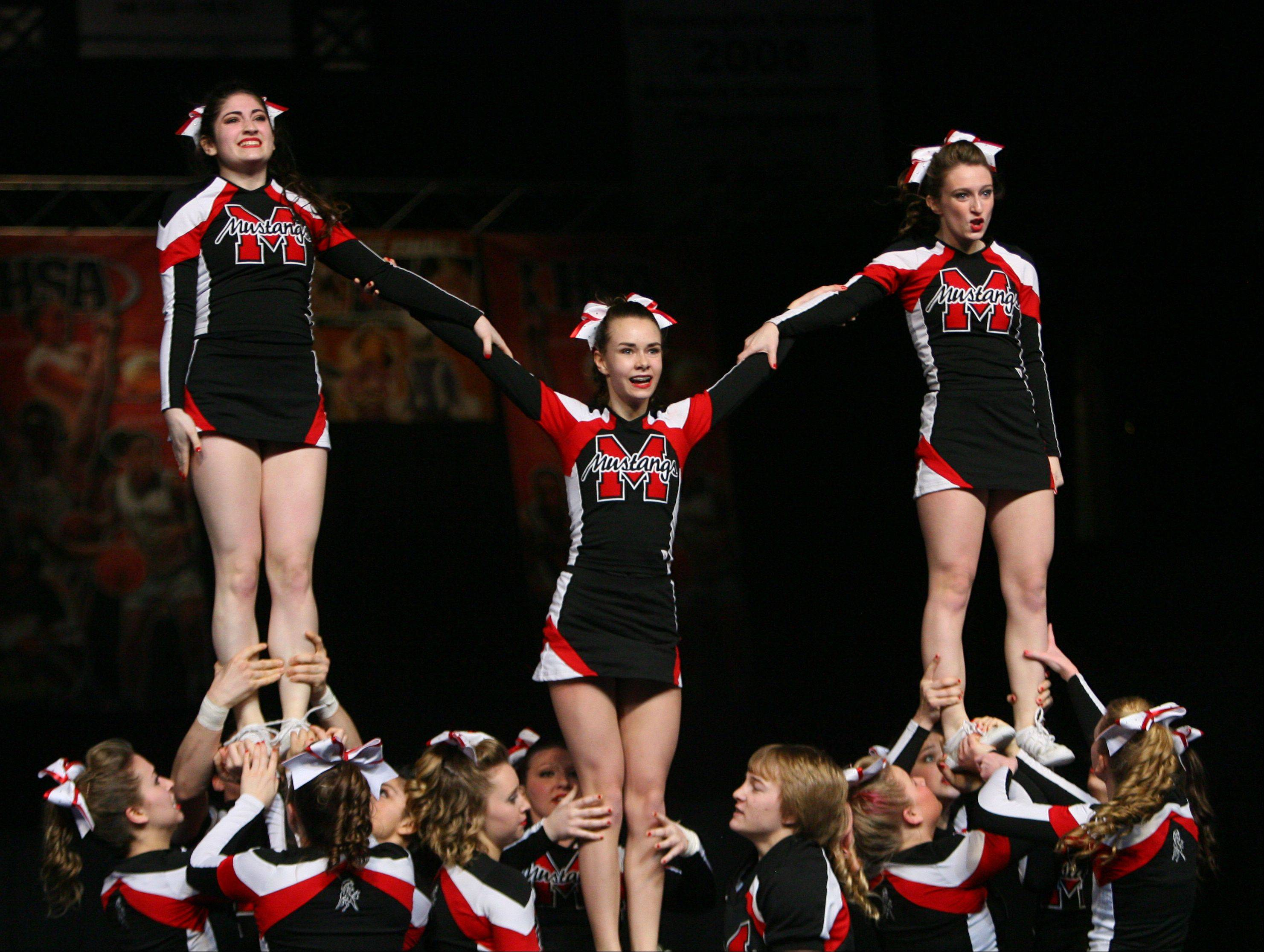 Mundelein High School participates in the IHSA Competitive Cheerleading finals on Saturday, Feb. 2 at the U.S. Cellular Coliseum in Bloomington.