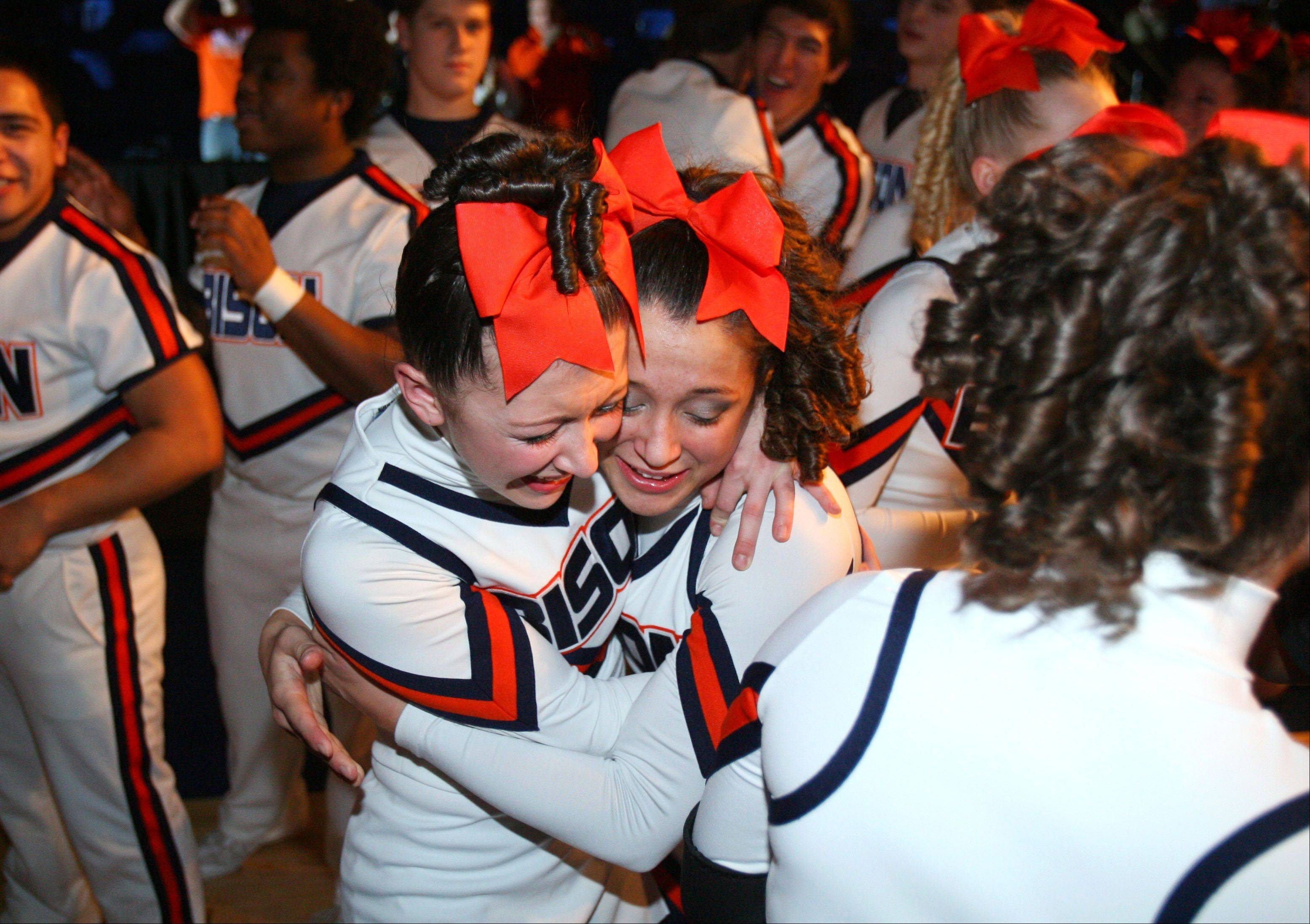 Buffalo Grove High School's large co-ed team celebrate after winning 1st place in the IHSA Competitive Cheerleading finals on Saturday, Feb. 2 at the U.S. Cellular Coliseum in Bloomington.
