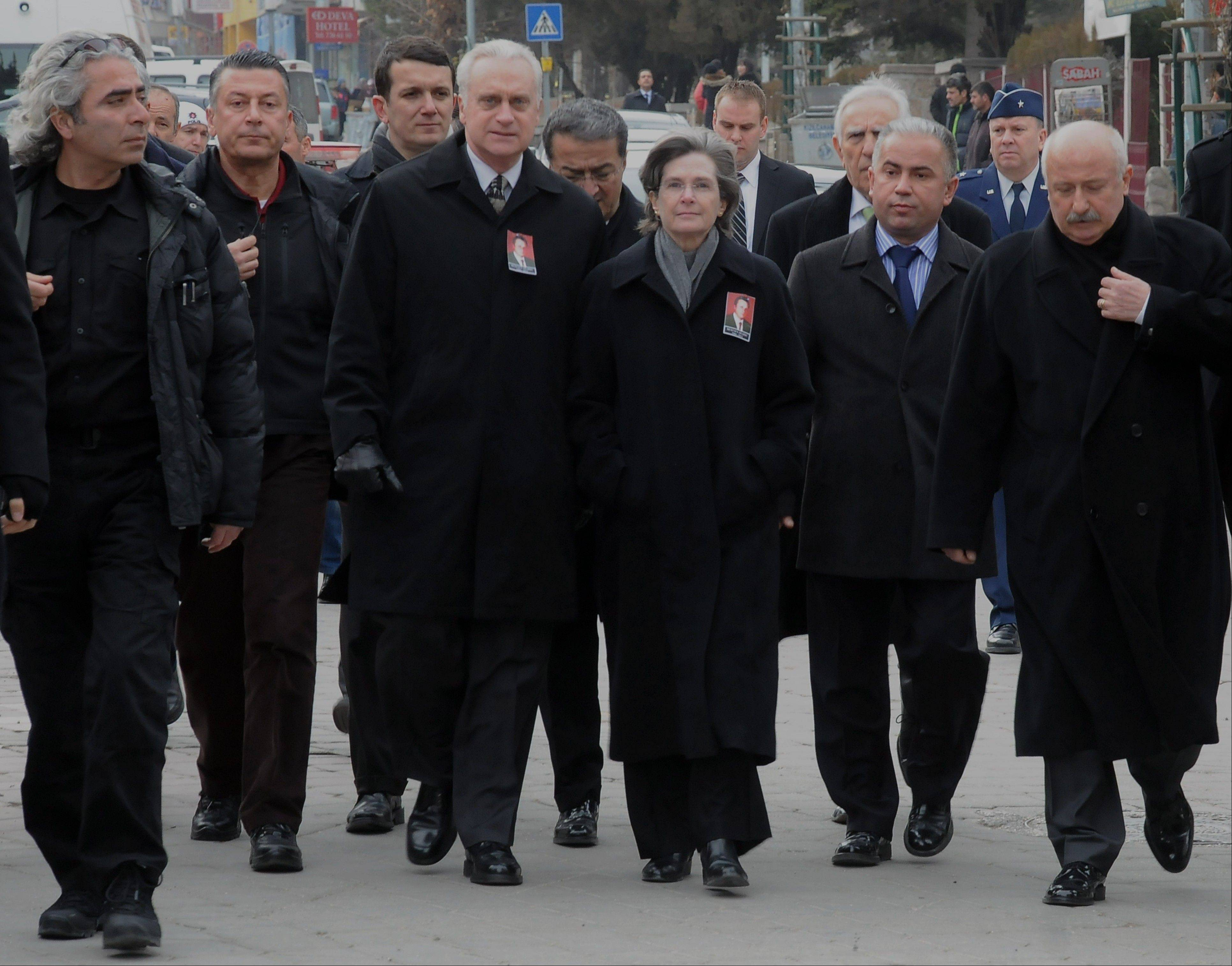 U.S. Ambassador to Turkey, Francis J. Ricciardone, third left, and his wife Marie arrive Saturday to attend the funeral ceremony for Mustafa Akarsu, an embassy security guard killed when a suicide bomber struck the American Embassy in Turkish capital on Friday.