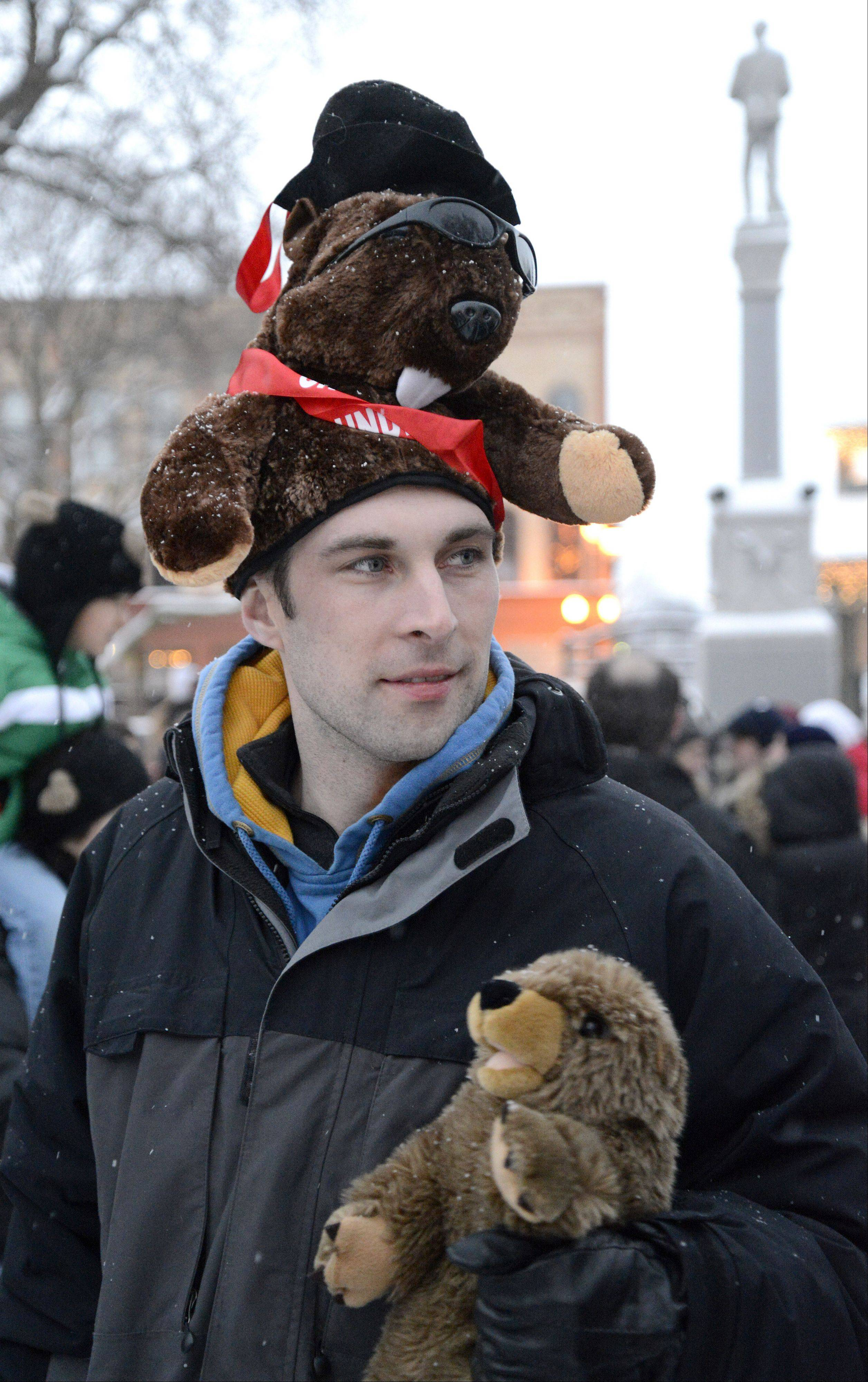 "Kyle Sweeney of Chicago celebrates Groundhog Day in Woodstock Square on Saturday. ""I'm the biggest Groundhog Day fan in the world,"" says Sweeney. He and seven friends from Chicago and Wisconsin rented an RV to come for the day."
