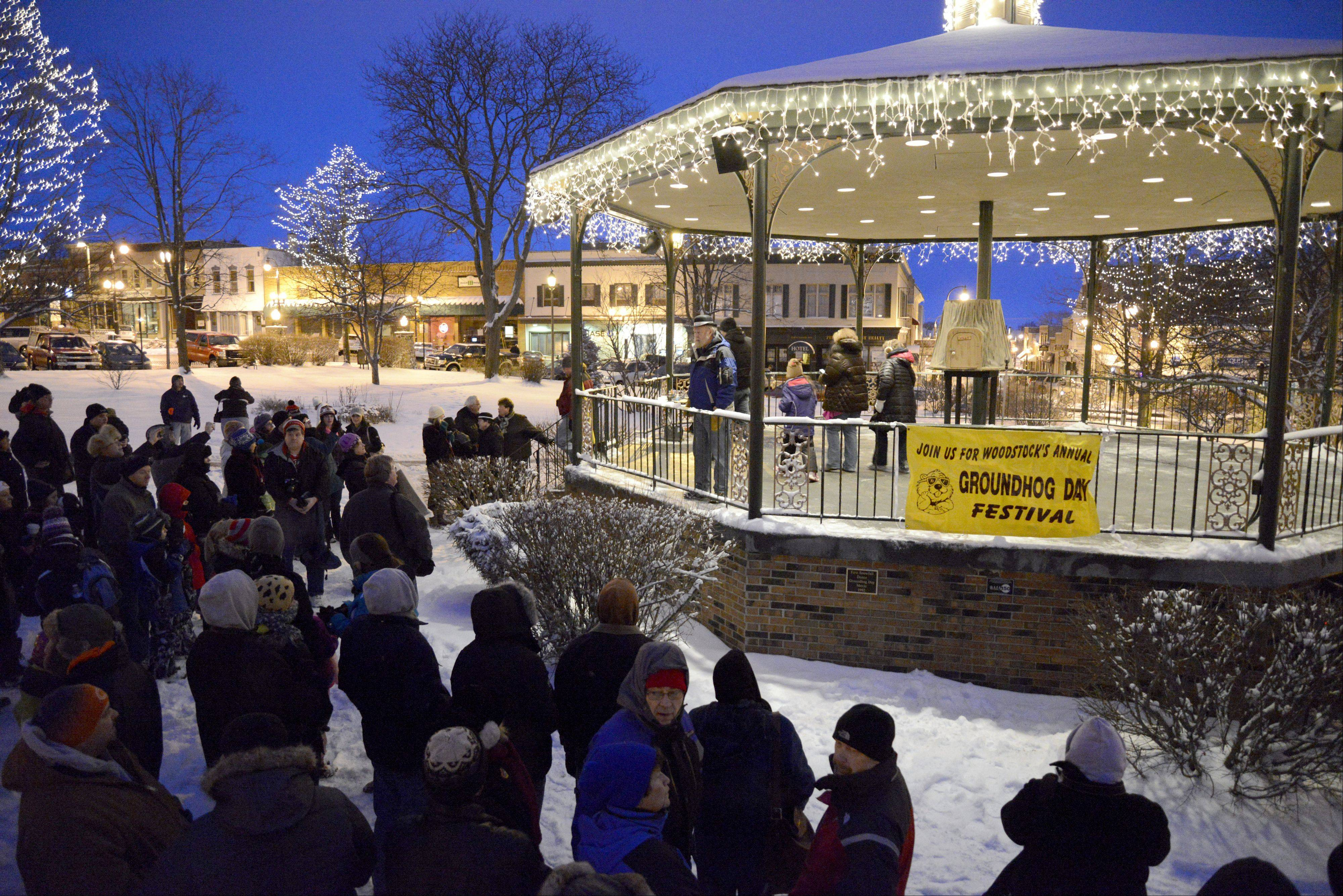 "Crowds start to gather before 6:30 a.m. at the Woodstock Square gazebo on Groundhog Day. The city is also celebrating the 20th anniversary of the filming of the movie ""Groundhog Day"" starring Bill Murray."