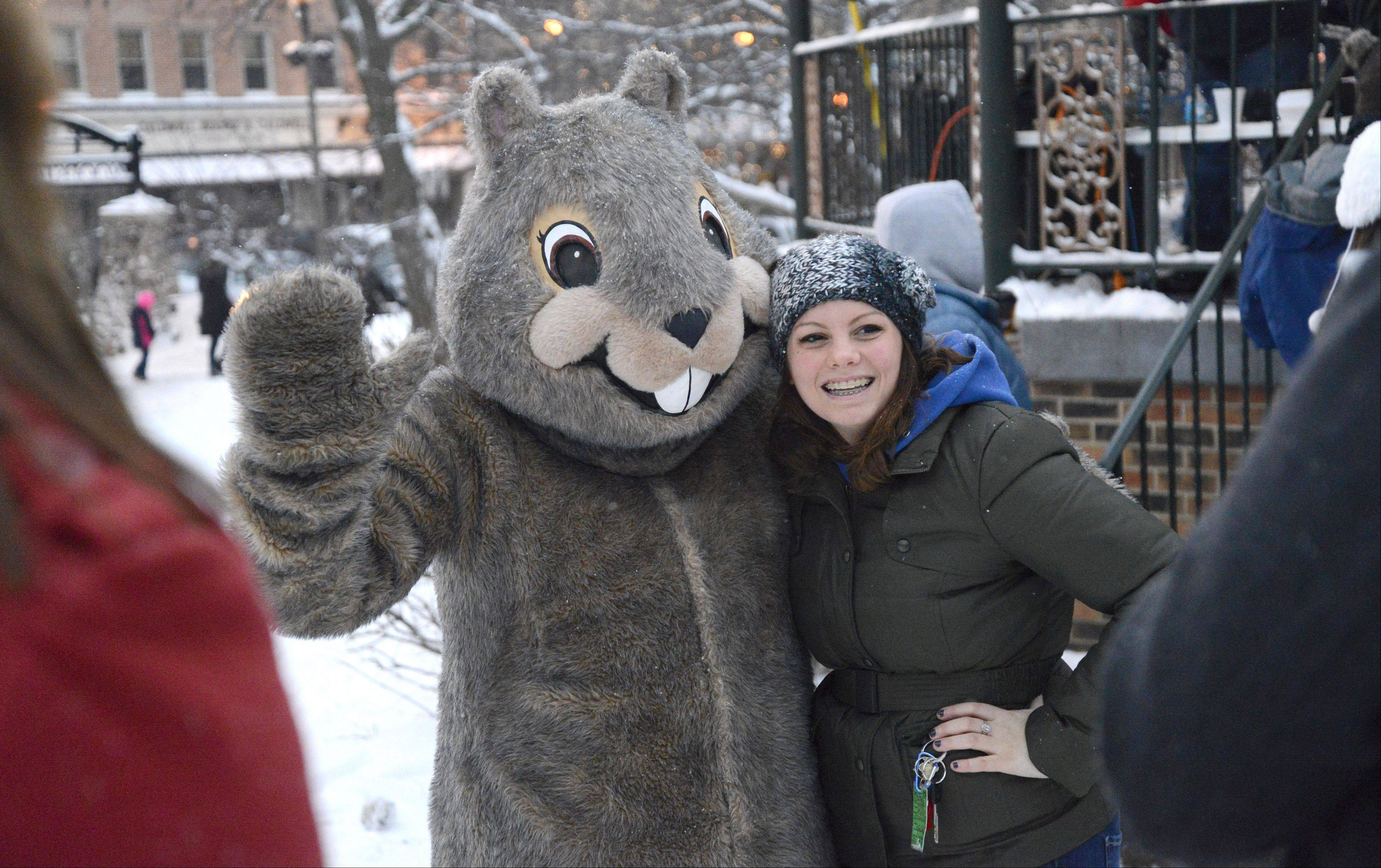 Ali Barlas of Woodstock gets her photo taken with Woodstock Willie during the Groundhog Day festivities in Woodstock Square on Saturday.