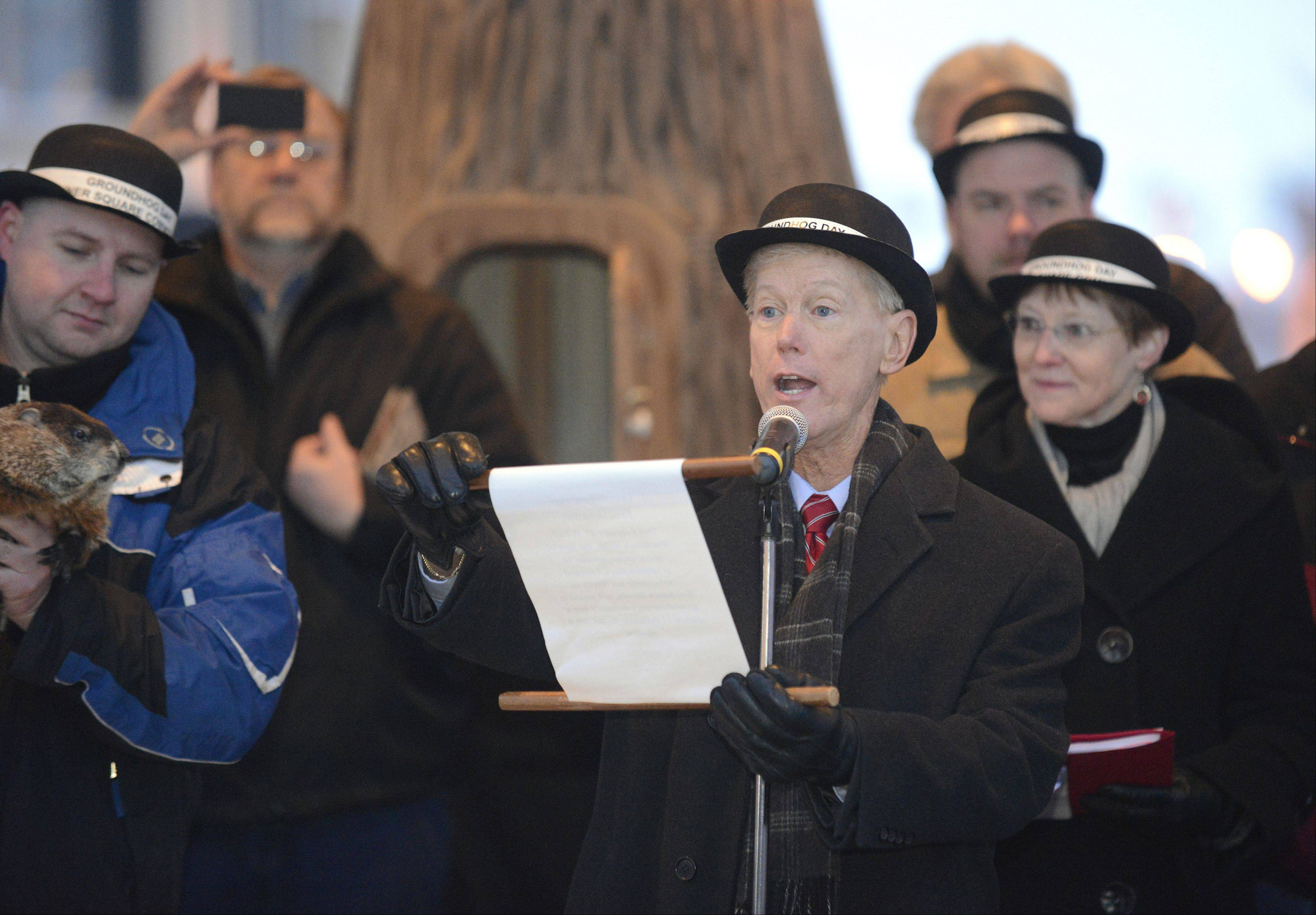 Woodstock Mayor Brian Sager reads the Groundhog Day proclamation in Woodstock Square on Saturday. Woodstock Willie did not see his shadow, so an early spring is predicted, despite the snowfall overnight.