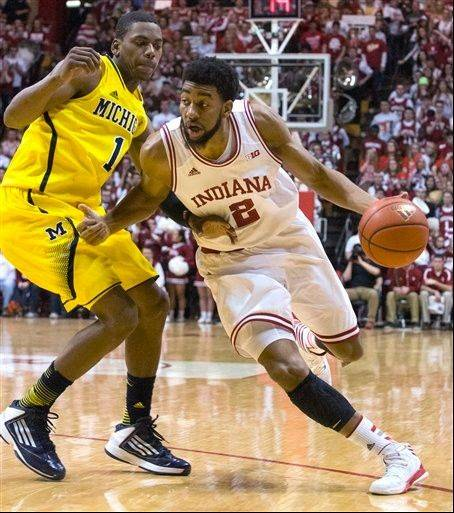 Indiana's Christian Watford (2) drives the ball up court against Michigan's Glenn Robinson III (1) Saturday in Bloomington, Ind. Indiana defeated Michigan 81-73.
