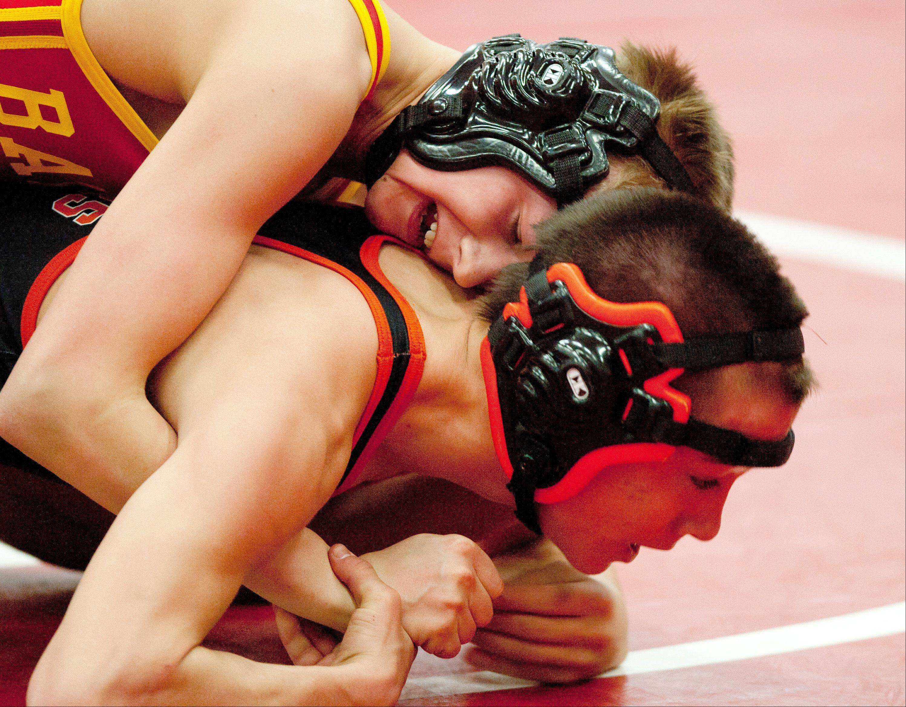 Batavia's Luke Schulz, top, defeats Wheaton Warrenville South' s Aaron Schliesmann 9-2 in the 113-pound class of the Class 3A Naperville Central Wrestling Regional.
