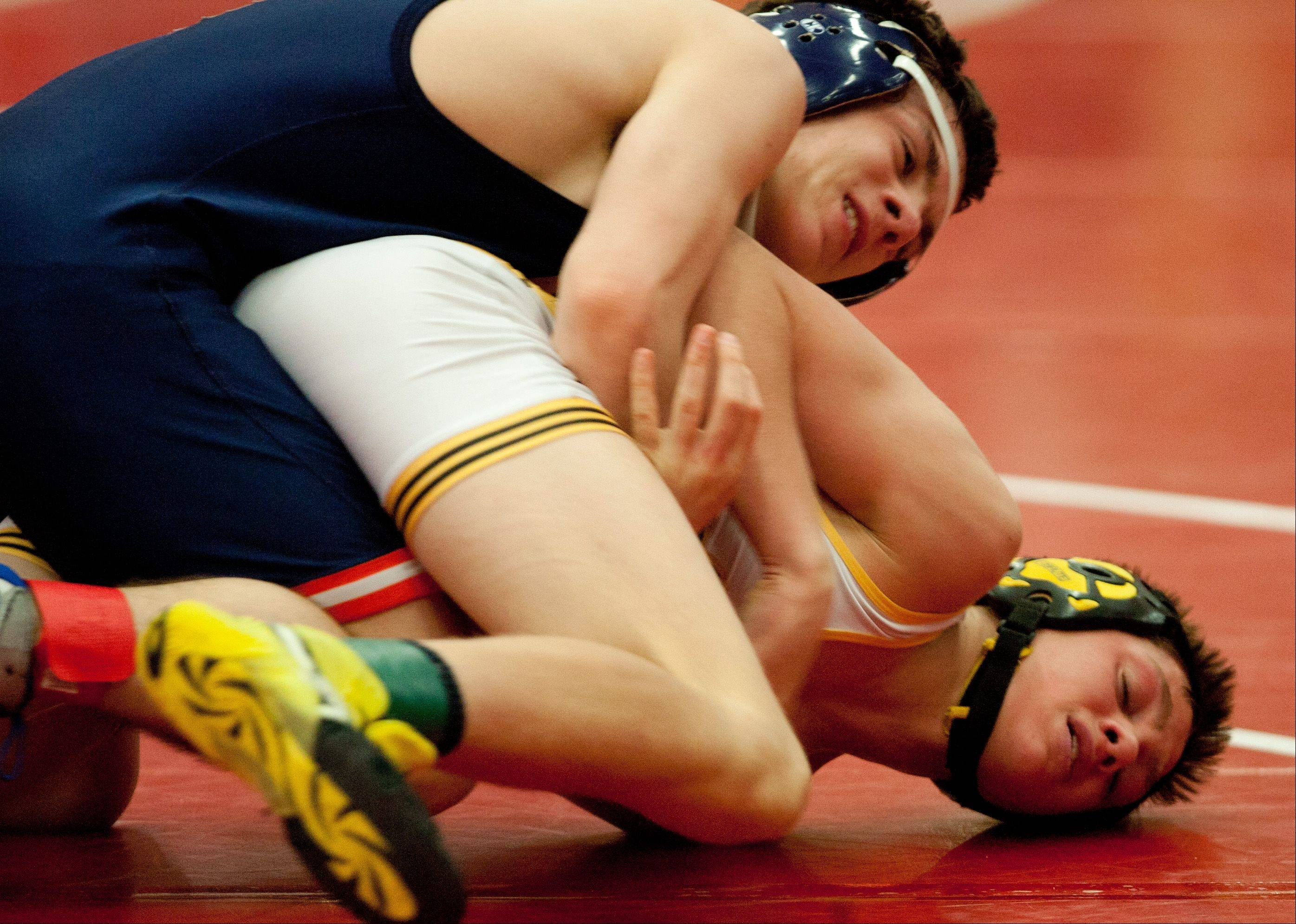 Naperville North's Jake Kruk, top, defeats Metea Valley's David Veitch in the 120-pound class of the Class 3A Naperville Central Wrestling Regional.