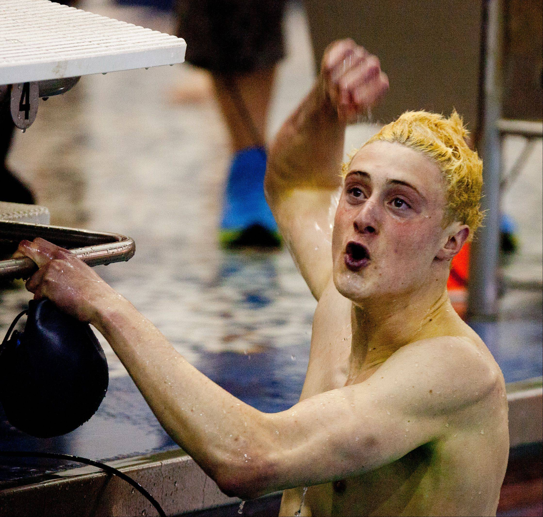 Jack Eichenberger, of West Chicago, reacts to his 50 yard freestyle time, during the DVC Swimming Conference Championship held at Naperville North High School.