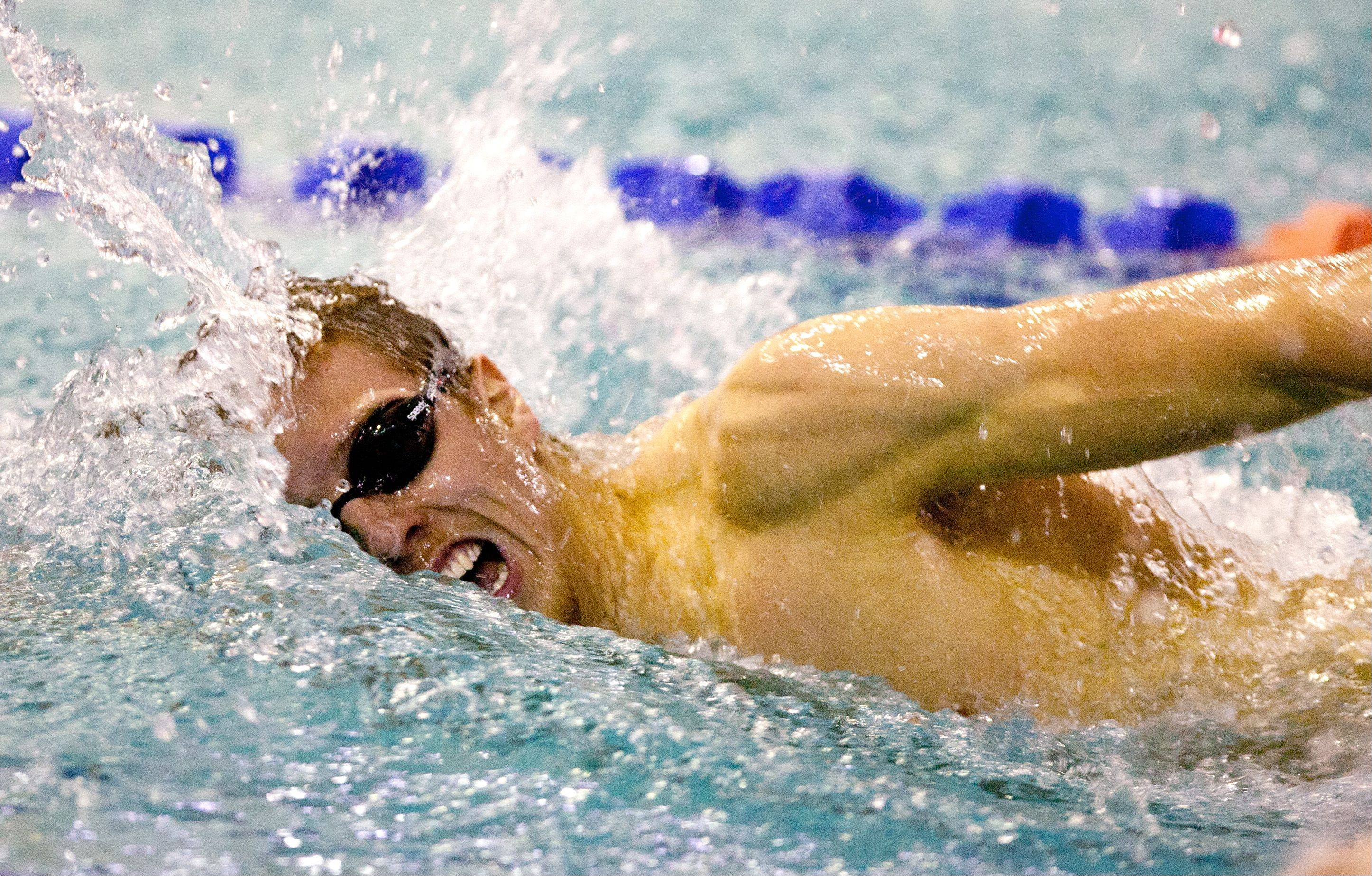Sam Hiller, of Naperville North High School, swims the 200 yard freestyle, during the DVC Swimming Conference Championship held at Naperville North High School.