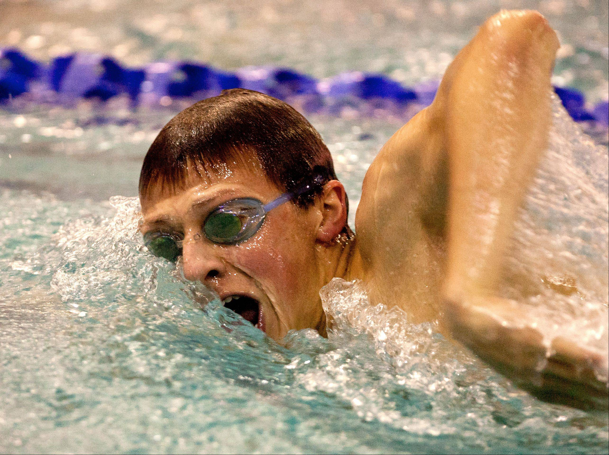 Tamas Rieser, of West Aurora High School, swims the 200 yard freestyle, during the DVC Swimming Conference Championship held at Naperville North High School.