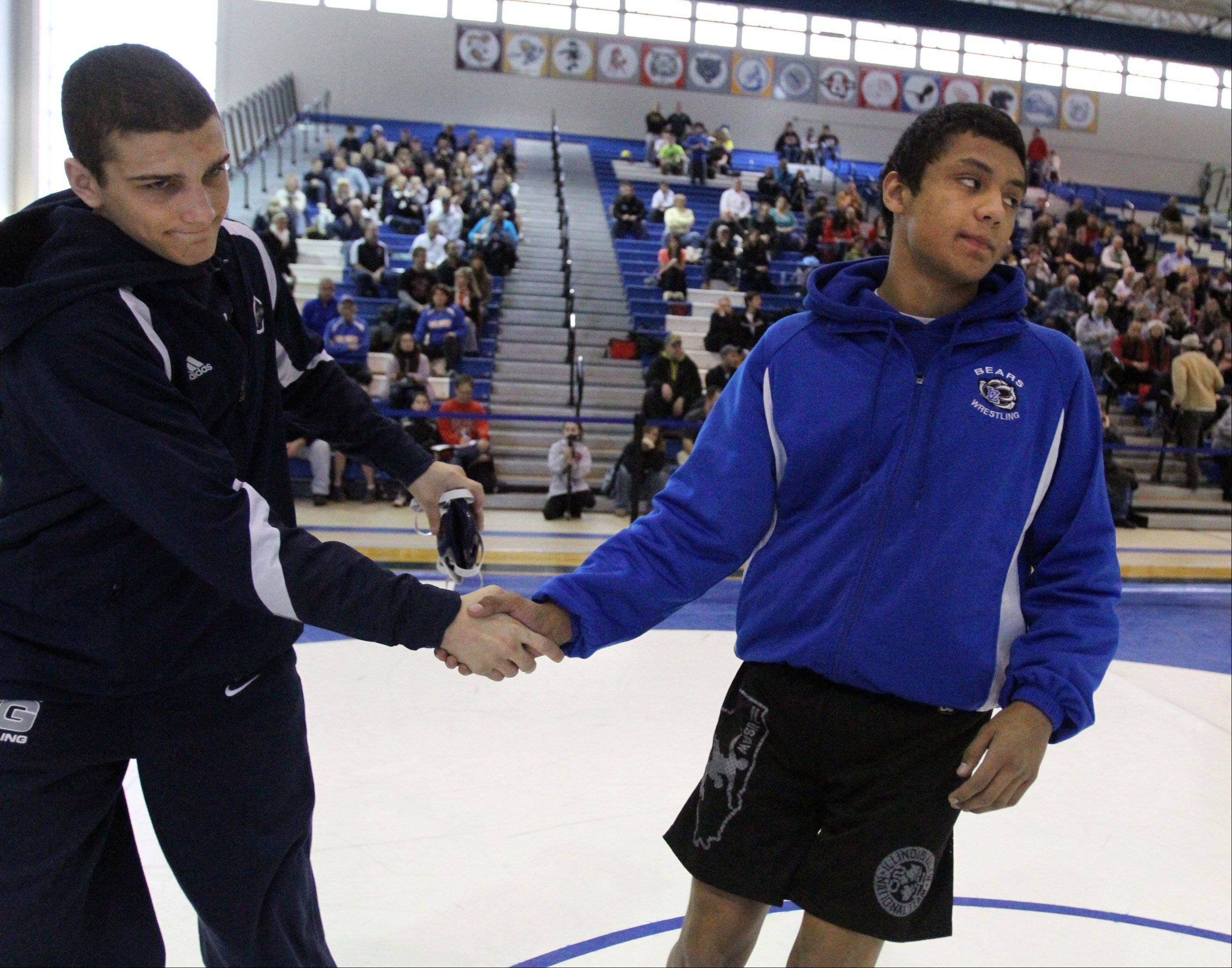 Cary-Grove's Michael Underwood, left, and Lake Zurich's Brandon Arteaga shake hands before the 138-pound championship match at the Class 3A regional at Lake Zurich on Saturday. Artega won the crown.