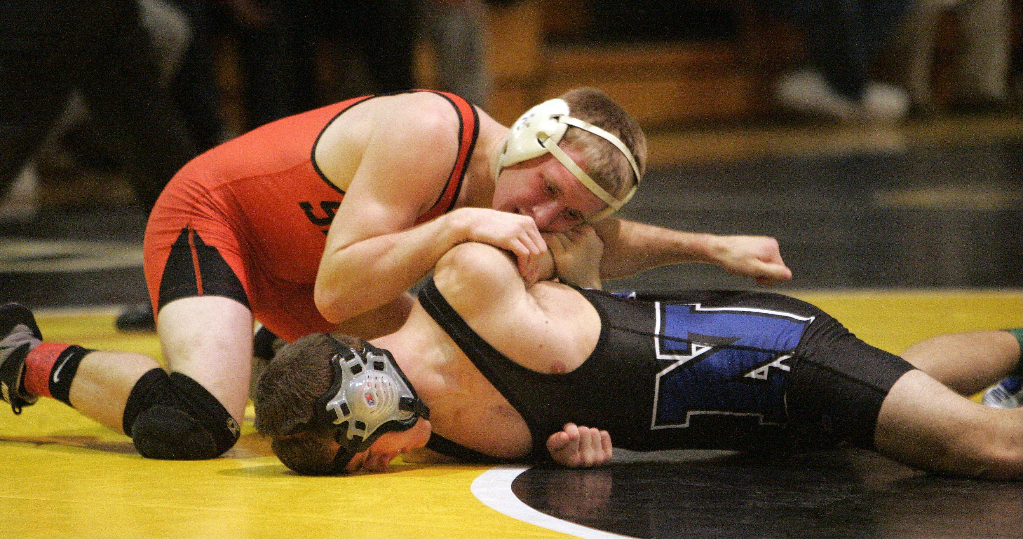 St. Charles East's Jake Mende wrestles St. Charles North's Kevin Deisher during the 138 pound IHSA Regional wrestling match for third place at Glenbard North Saturday February 2, 2013. Mende won the match.