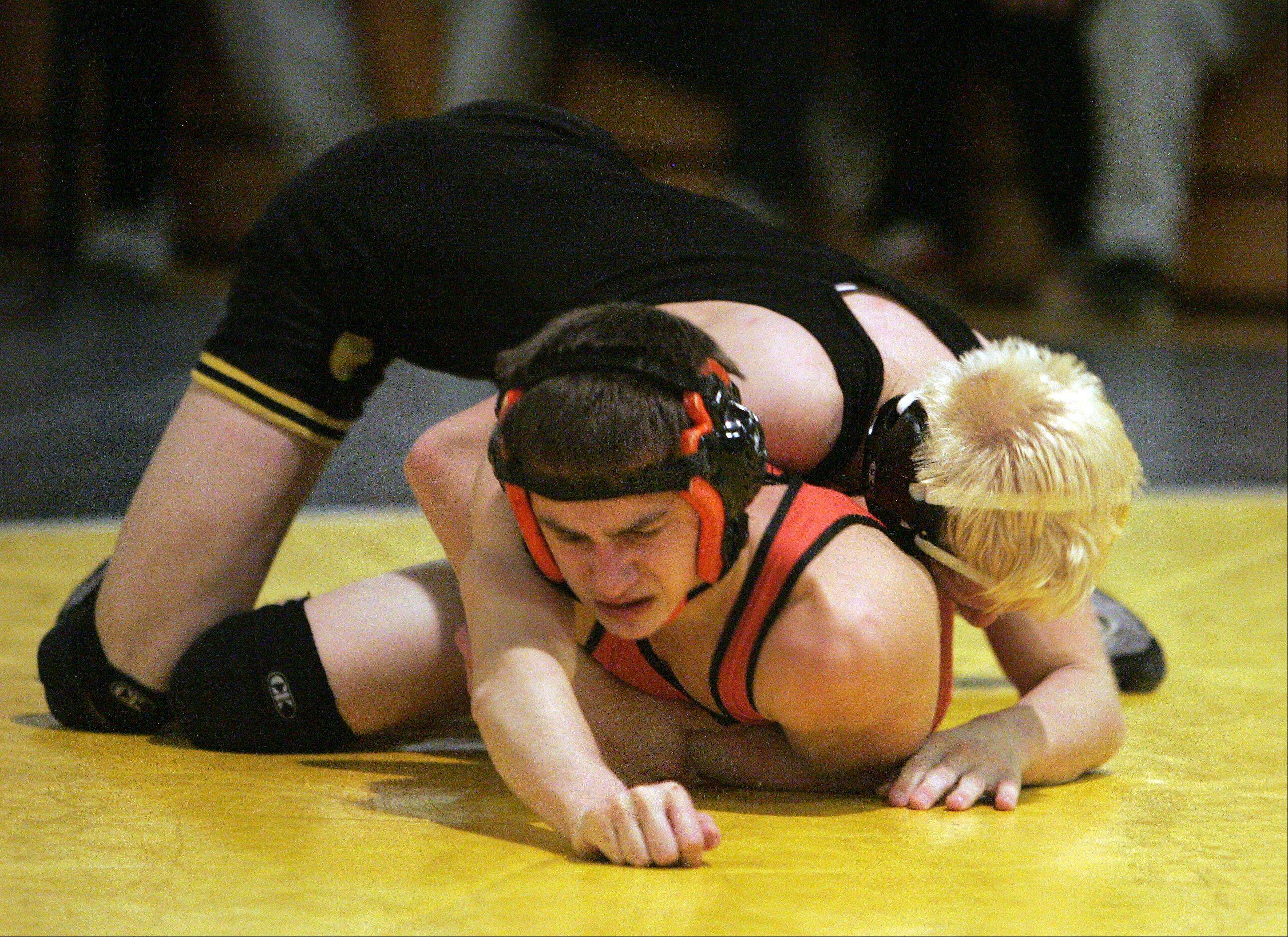 St. Charles East's Ryan Rubino takes on Glenbard North's Patrick Augustyn during the 106 pound IHSA Regional wrestling match for first place at Glenbard North Saturday February 2, 2013.