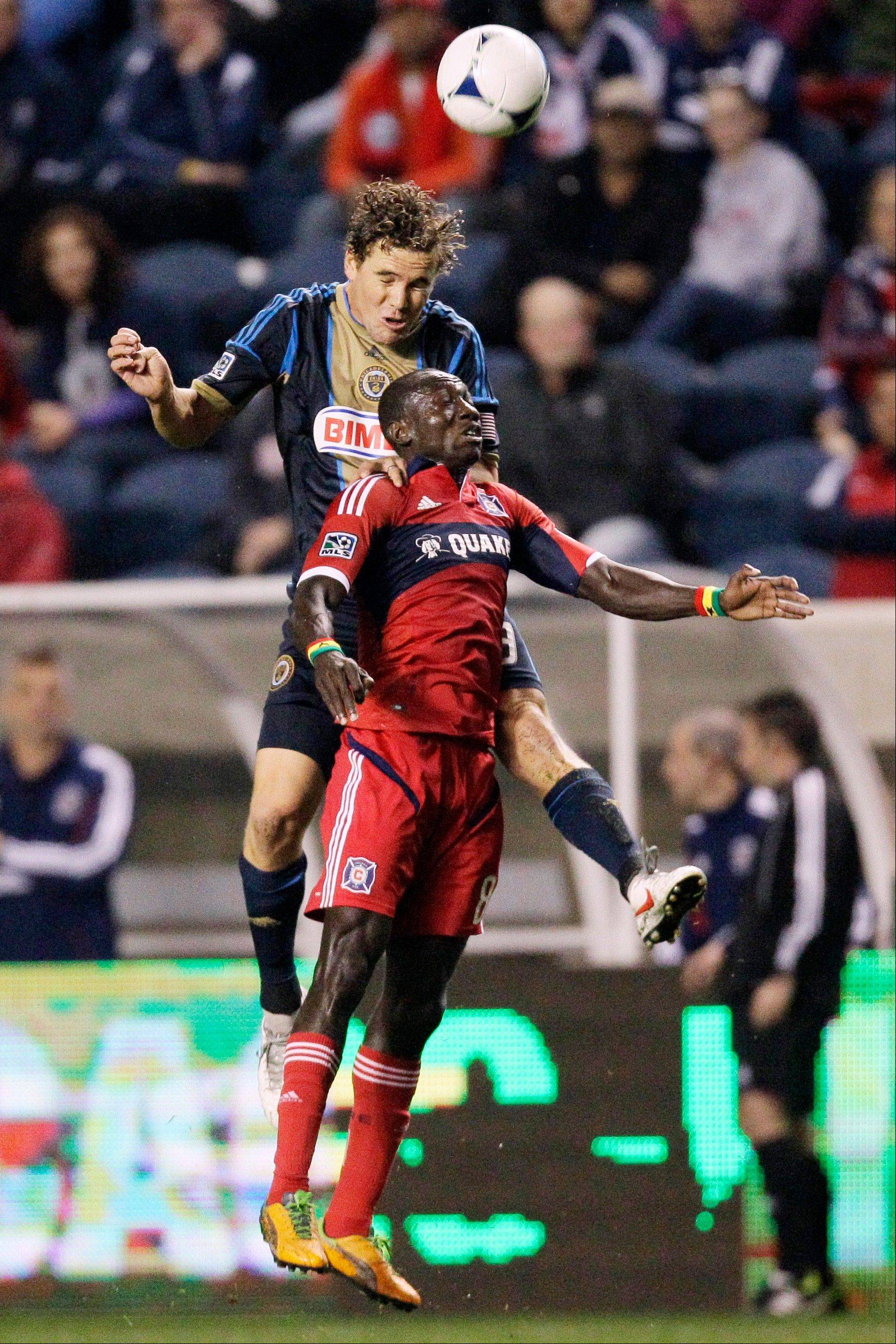 Philadelphia Union defender Chris Albright, top, and Chicago Fire forward Dominic Oduro (8) head the ball during the second half of an MLS soccer match, Wednesday, Oct. 3, 2012, in Bridgeview, Ill. The Union won 3-1.