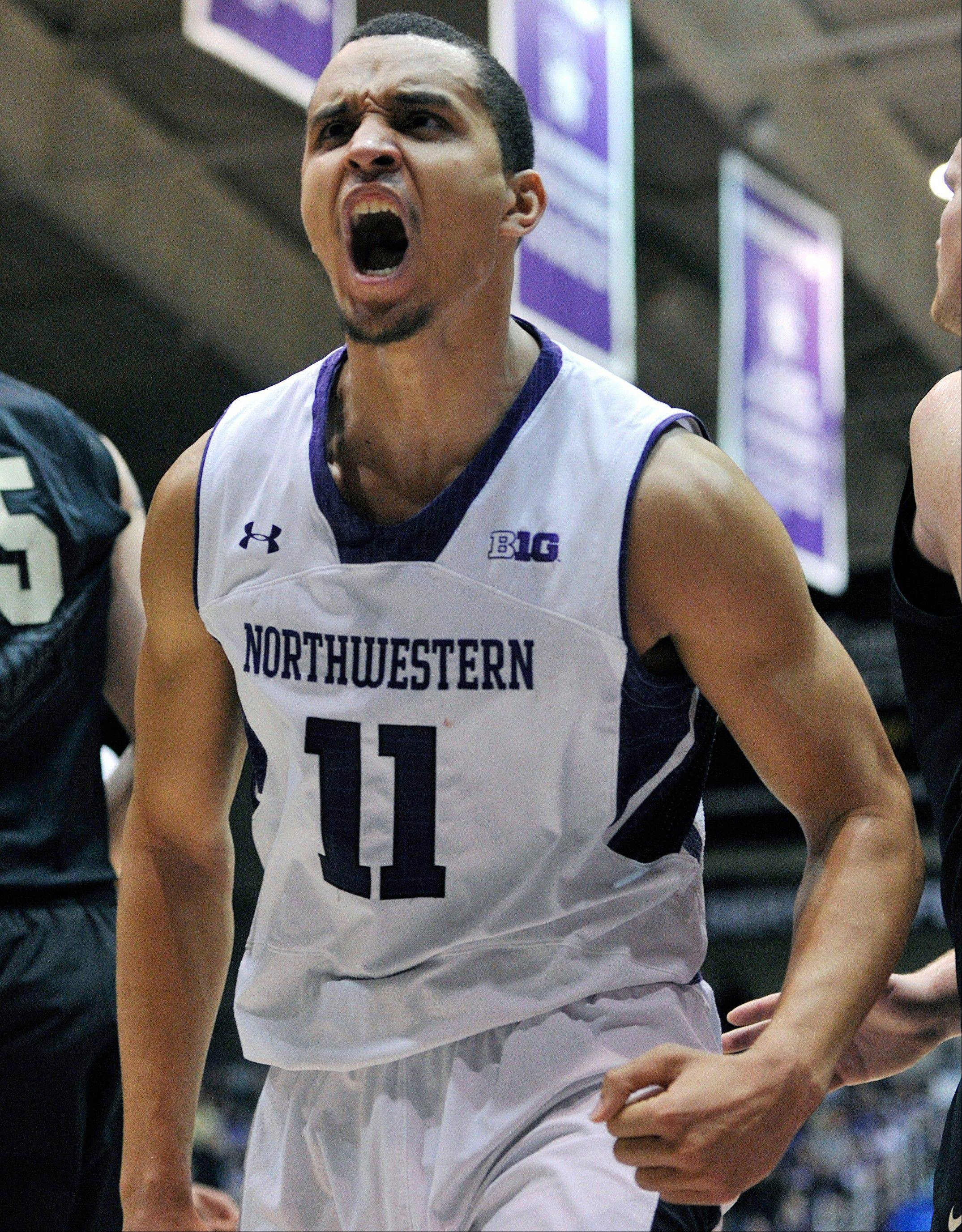 Northwestern's Reggie Hearn celebrates a basket against Purdue Saturday during the second half.