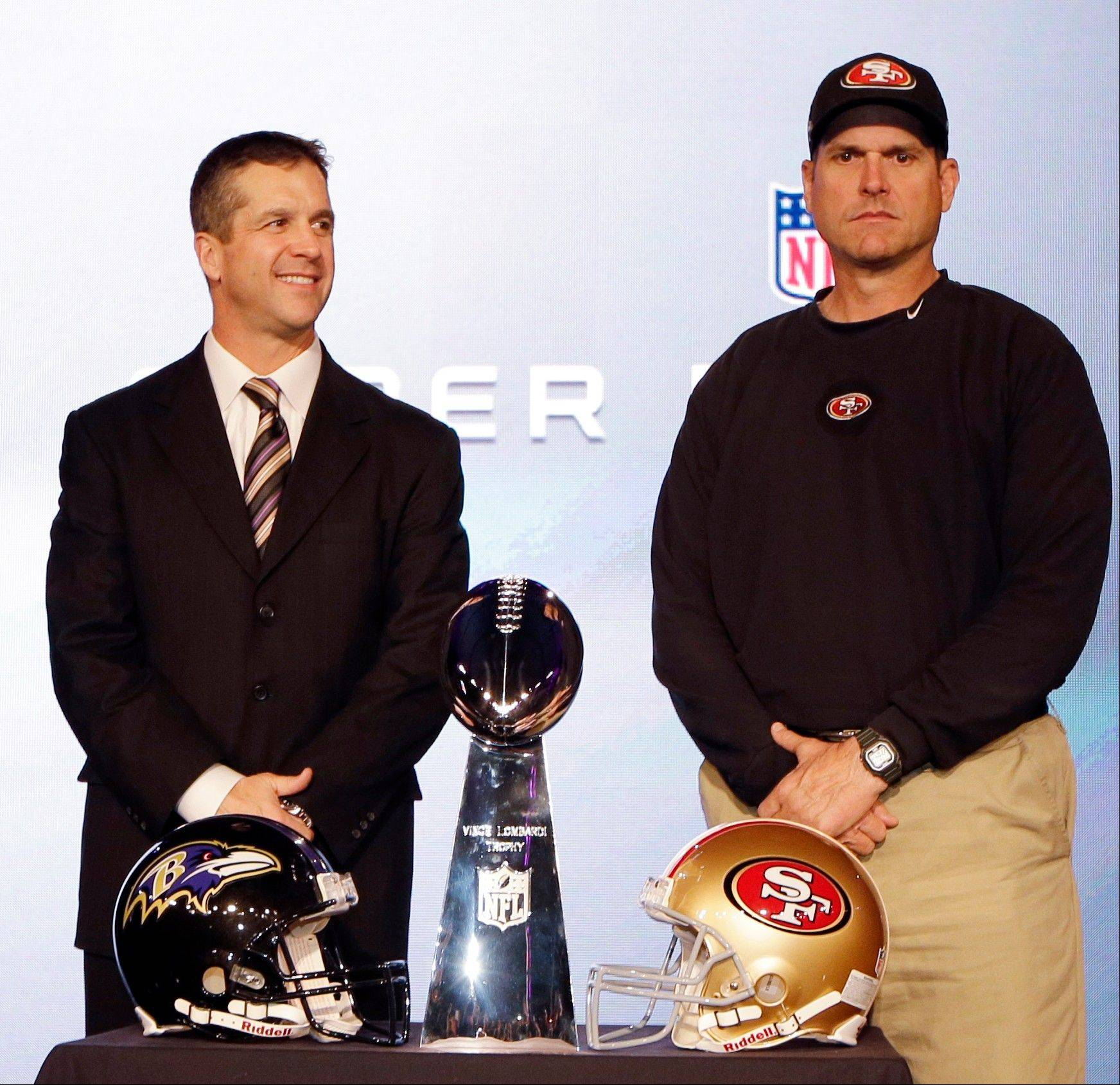 San Francisco 49ers head coach Jim Harbaugh and Baltimore Ravens head coach John Harbaugh participate Friday in a news conference before Super Bowl XLVII.