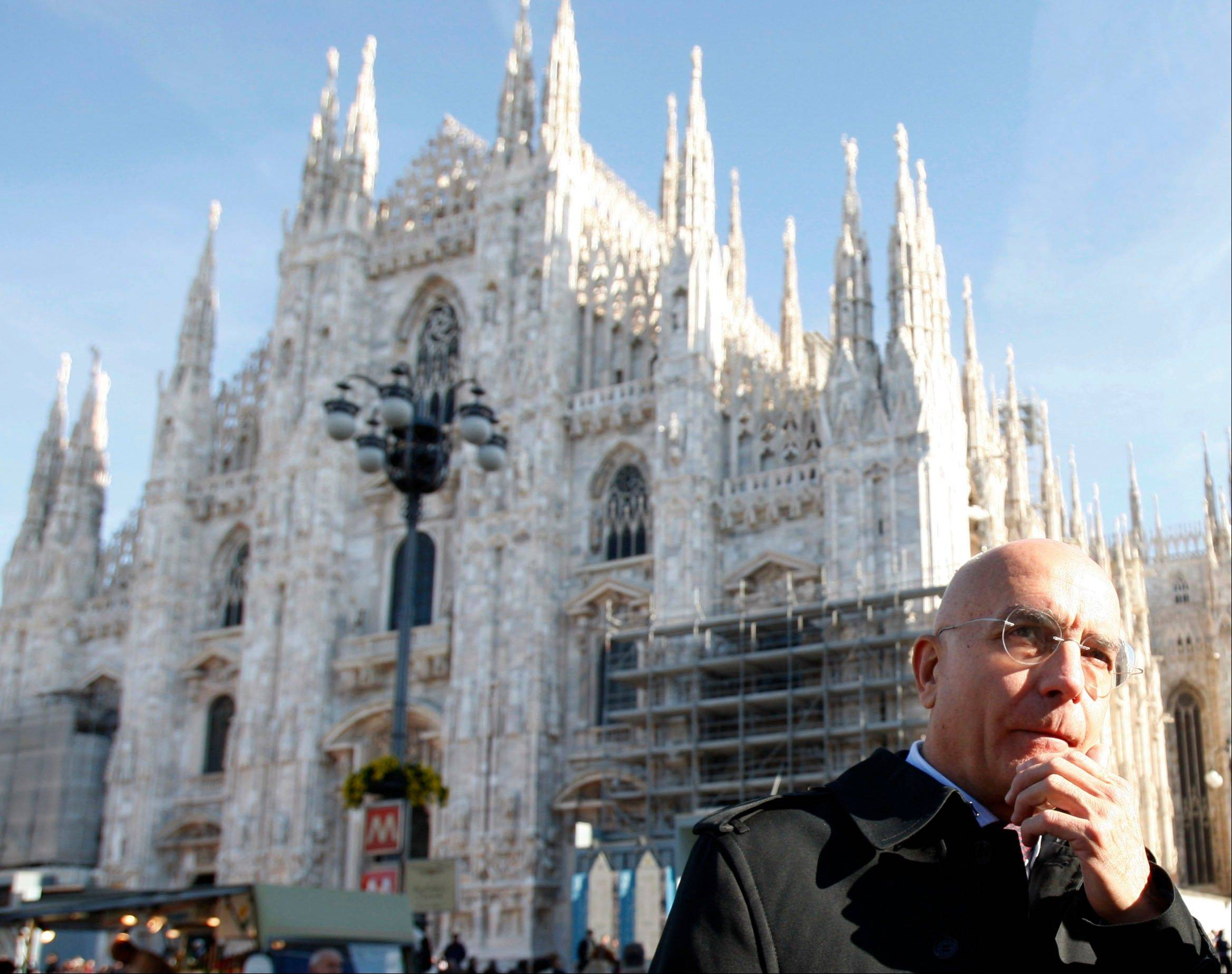 Gabriele Albertini stands in front of the Milan gothic cathedral in Italy. Lombardy, Italy's most populous and economically productive region, is a key battleground in the upcoming national elections, with the regional race not only likely to determine who can most reliably govern the euro zone's third-largest economy but also testing emerging political alliances.