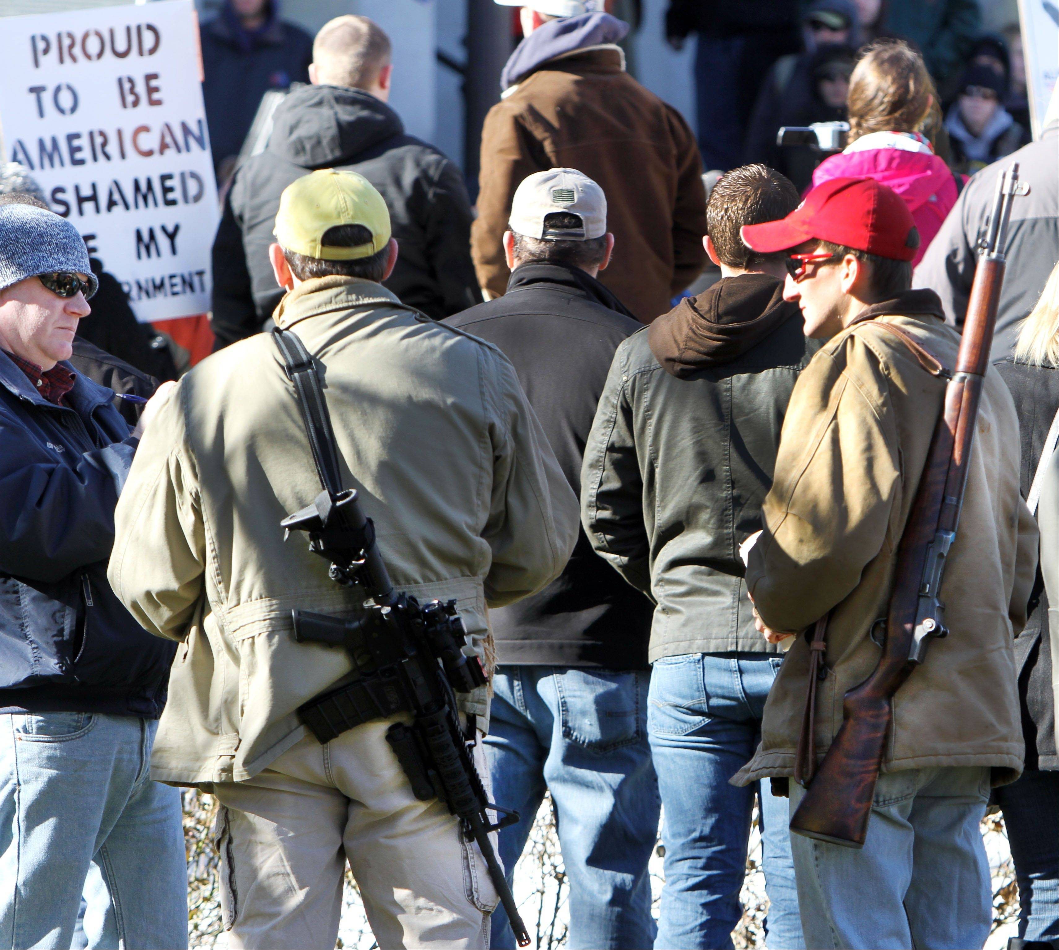 Gun owners rally to promote the right to bear arms in front of the Statehouse in Concord, N.H., Thursday. Speakers criticized Democrats in Washington for favoring new gun control laws following the Connecticut school shooting that left 26 dead last month.