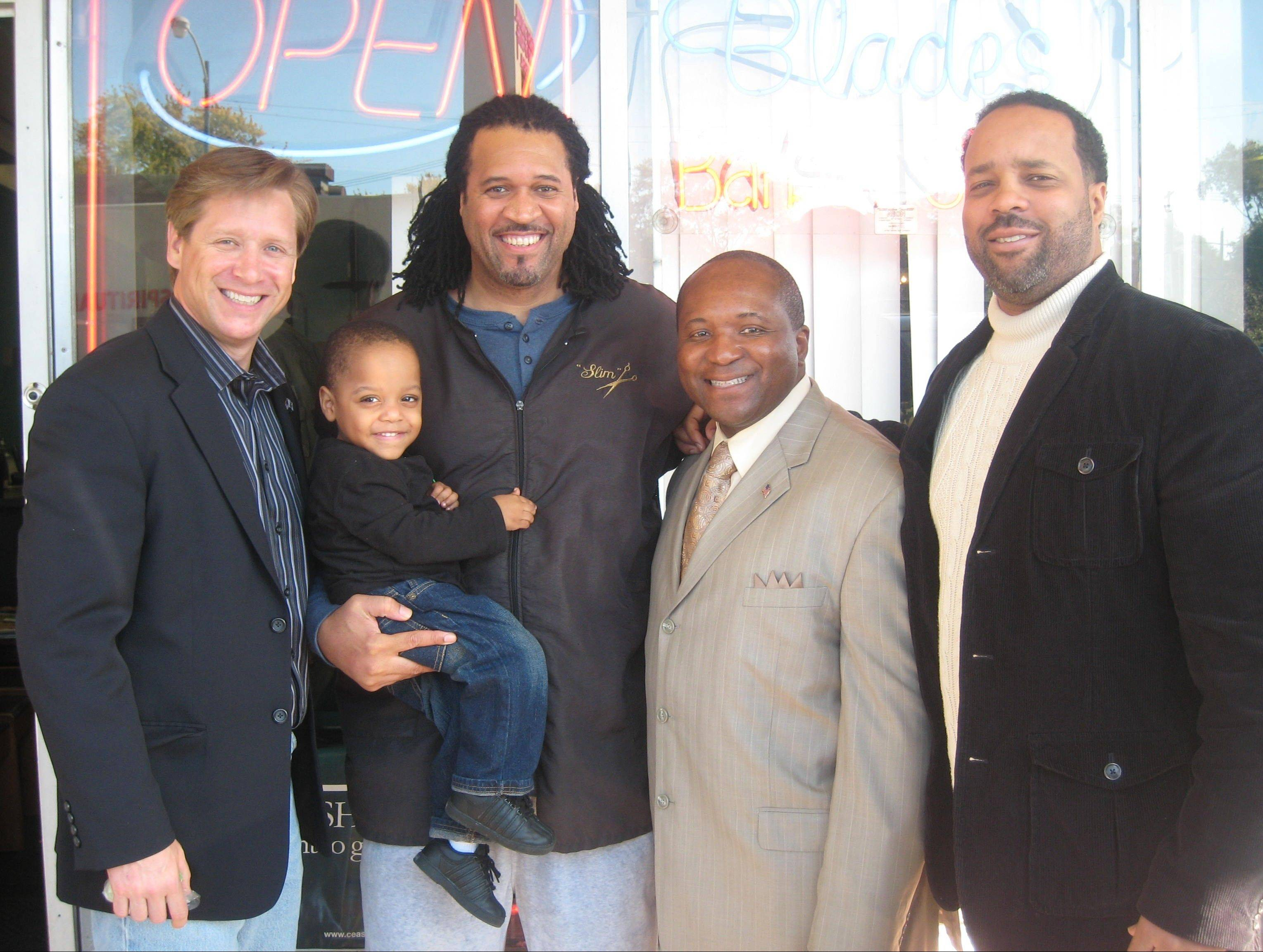 Illinois Sen. Dan Duffy, left, of Lake Barrington, got to know Jeffery Coleman, far right, and his brother Philip, during Barbershop Tours held for politician on the South Side of Chicago. Duffy is now researching legislation to better regulate the use of stun guns, after Philip Coleman died after Chicago police used a stun gun on him twice.