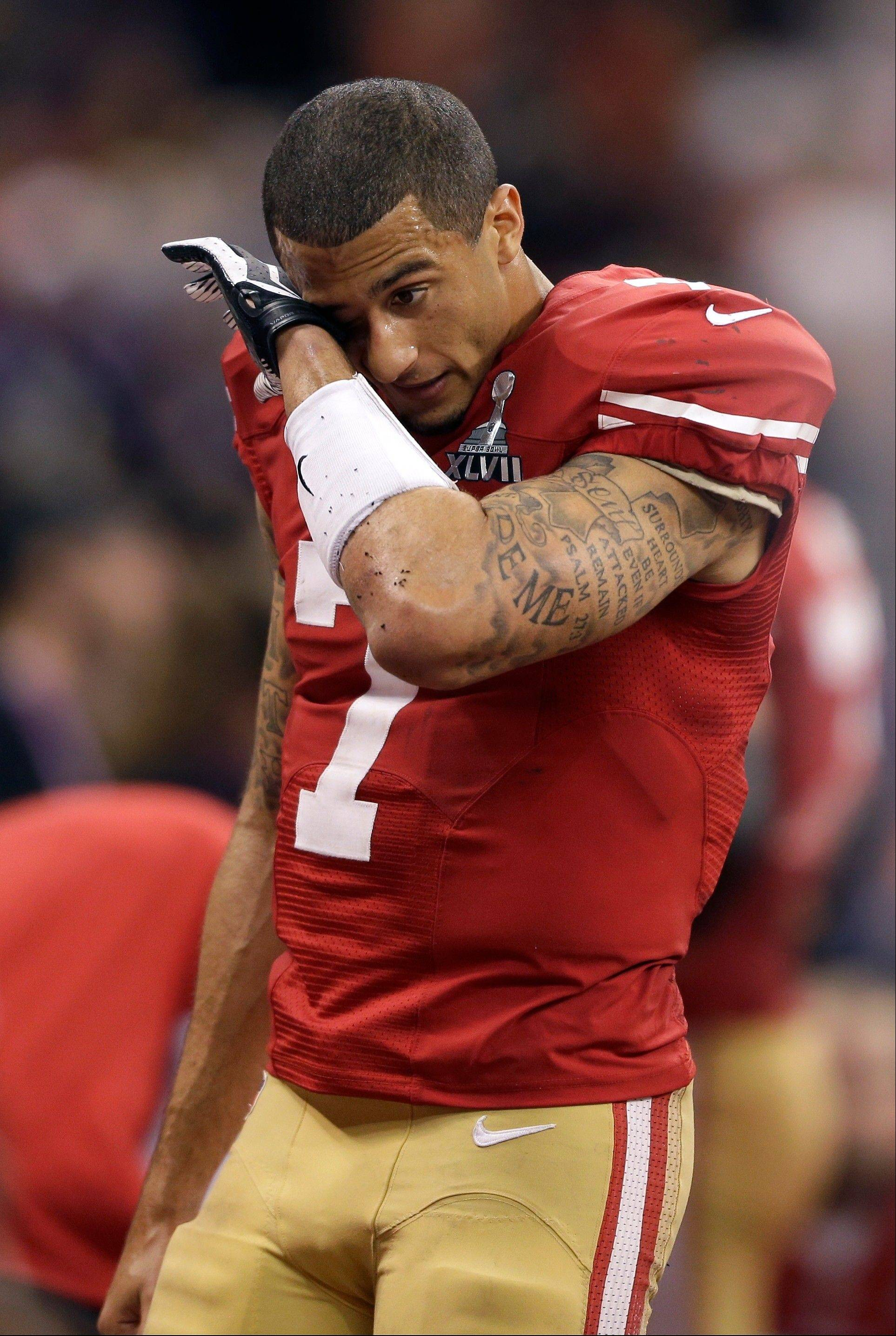 San Francisco 49ers quarterback Colin Kaepernick wipes his face after losing 34-31 to the Baltimore Ravens in the Super Bowl XLVII. Kaepernick finished 16 for 28 for 302 yards, threw one touchdown and ran for another.