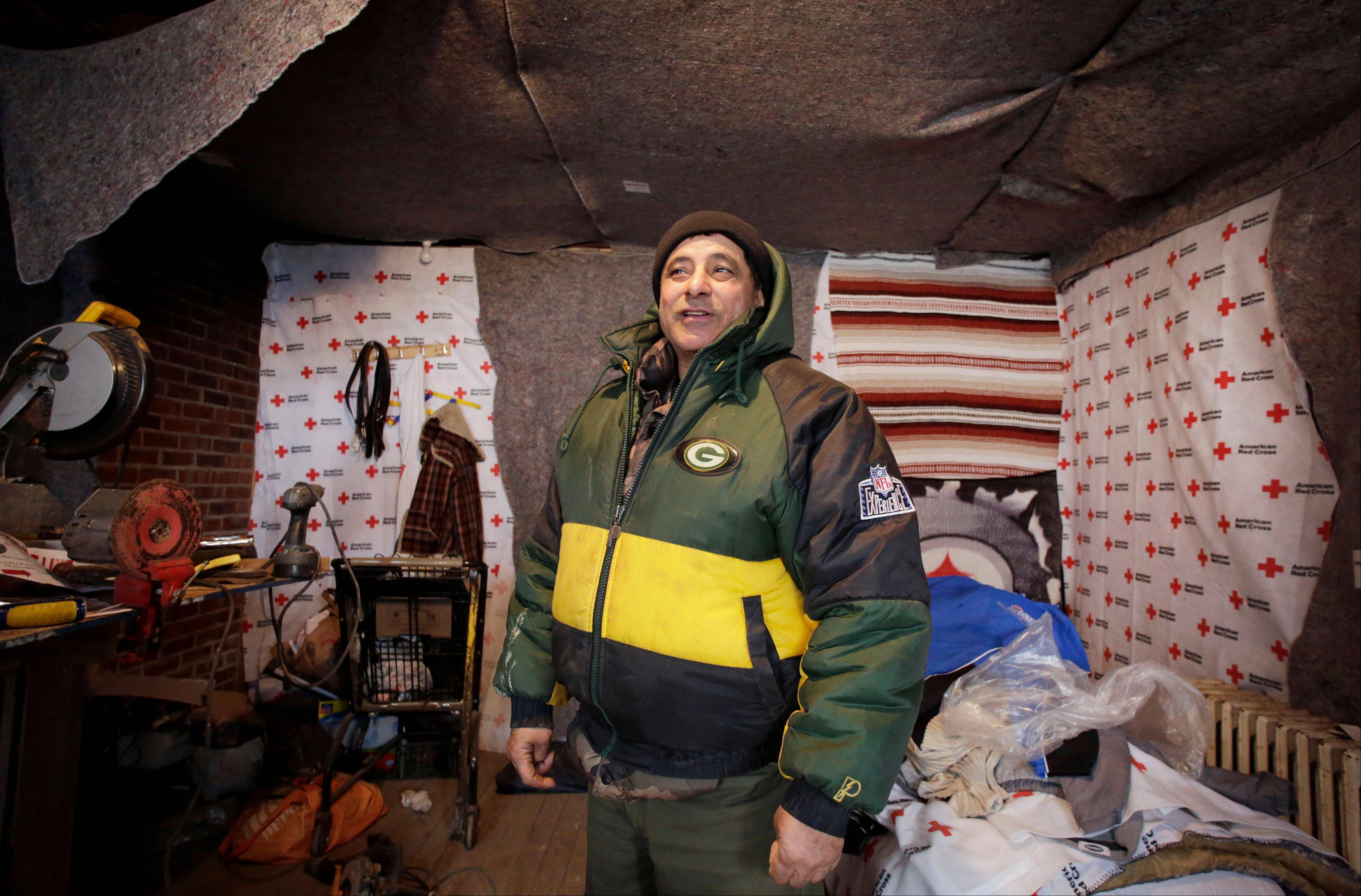 Eddie Saman shows how he insulated his home with blankets donated by the Red Cross, in the Staten Island borough of New York. The house was badly damaged by Superstorm Sandy and will have to be renovated.