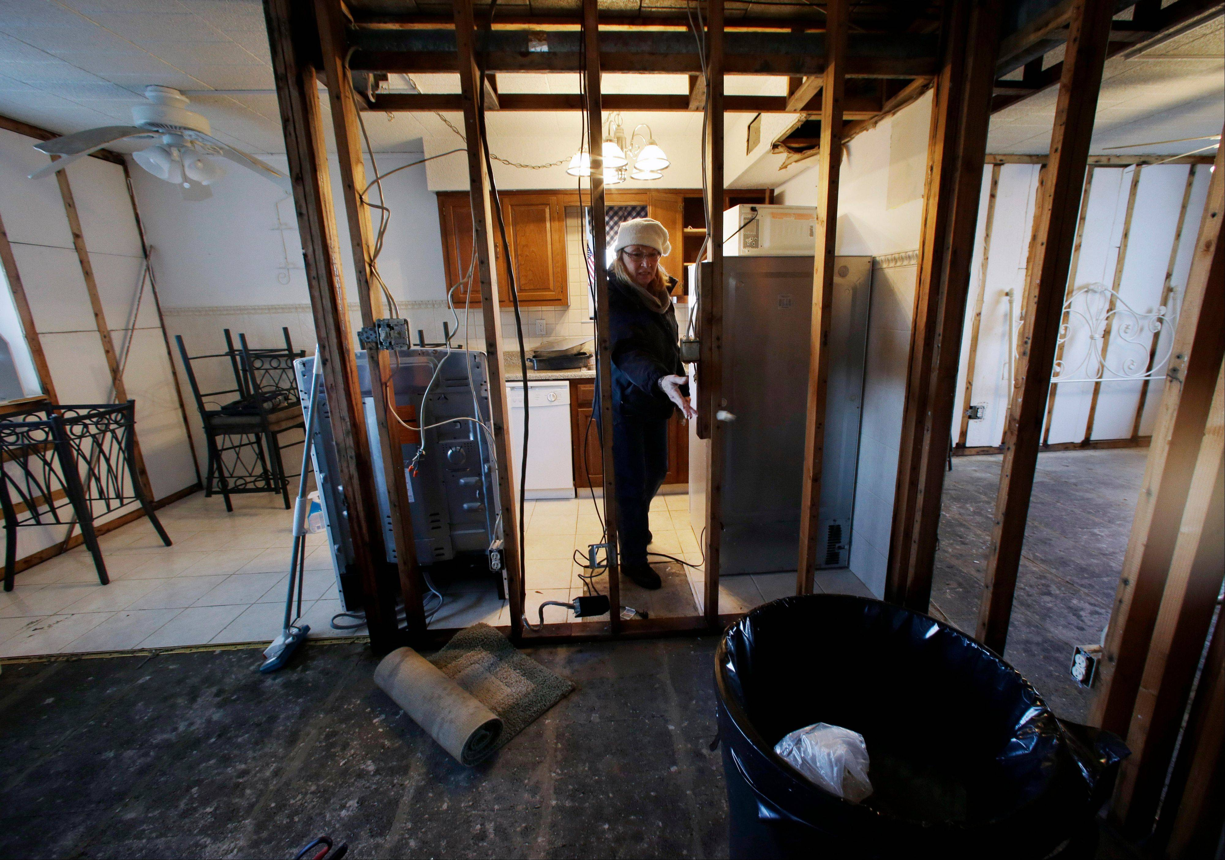 Kim Baker works to clean up her Superstorm Sandy-damaged home in Seaside Heights, N.J.