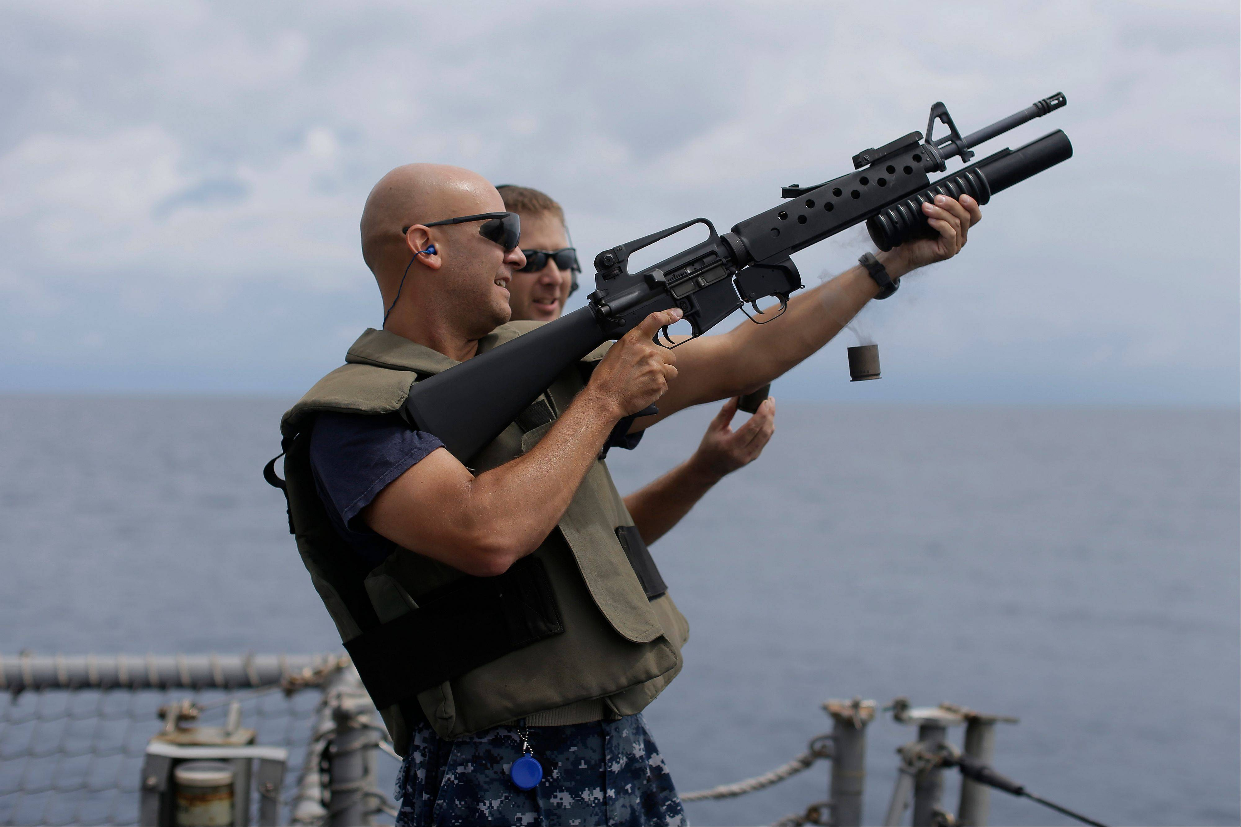 The captain of the USS Underwood, Peter T. Mirisola, fires a grenade launcher during small arms qualifications onboard the ship while patrolling in international waters near Panama. In the most expensive initiative in Latin America since the Cold War, the U.S. has militarized the battle against drug traffickers, spending more than $20 billion in the past decade. U.S. Army troops, Air Force pilots and Navy ships outfitted with Coast Gua