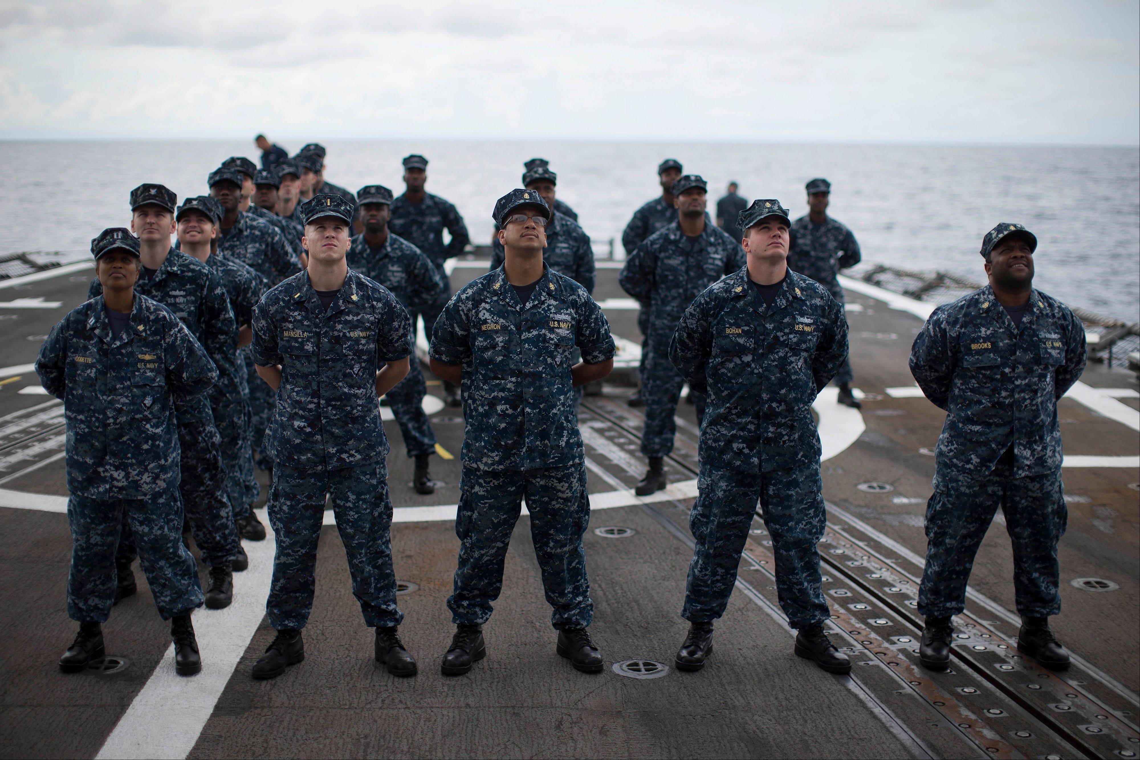 Sailors pose for a photo on the flight deck of the USS Underwood while patrolling in international waters near Panama.
