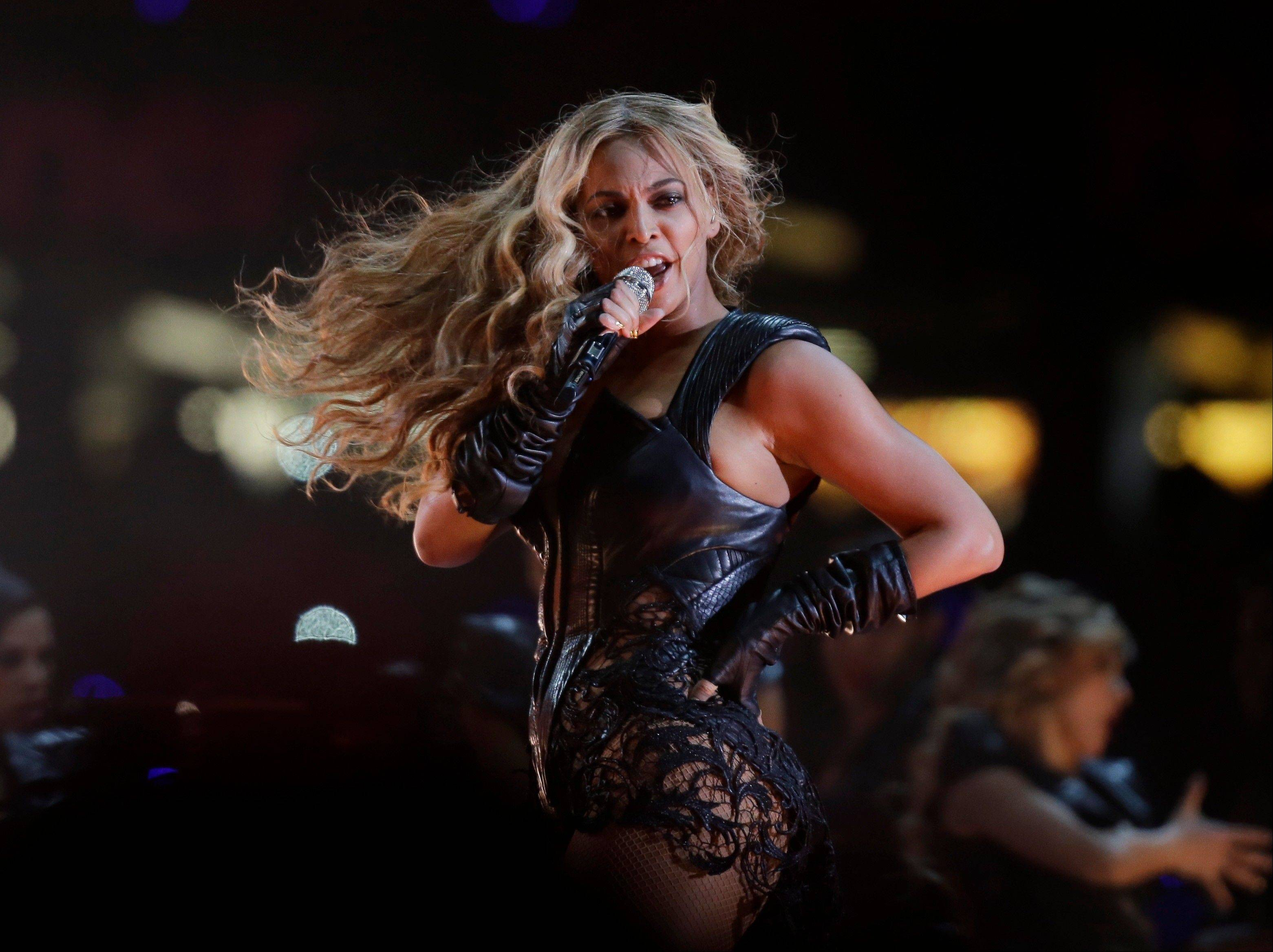 Beyonce performs during the halftime show .
