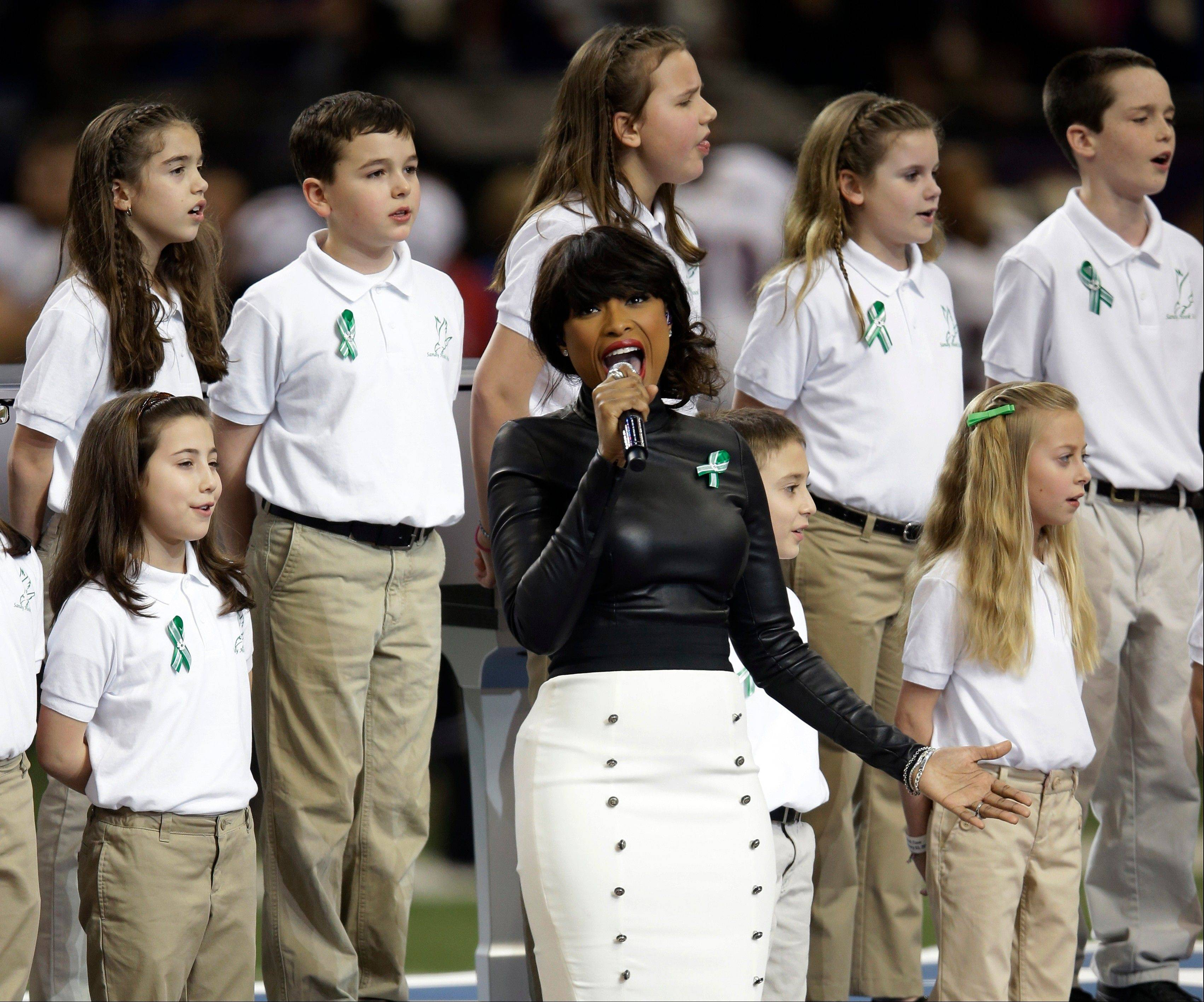 "Jennifer Hudson and students from Sandy Hook Elementary School sing ""God Bless America"" before the Super Bowl XLVII."