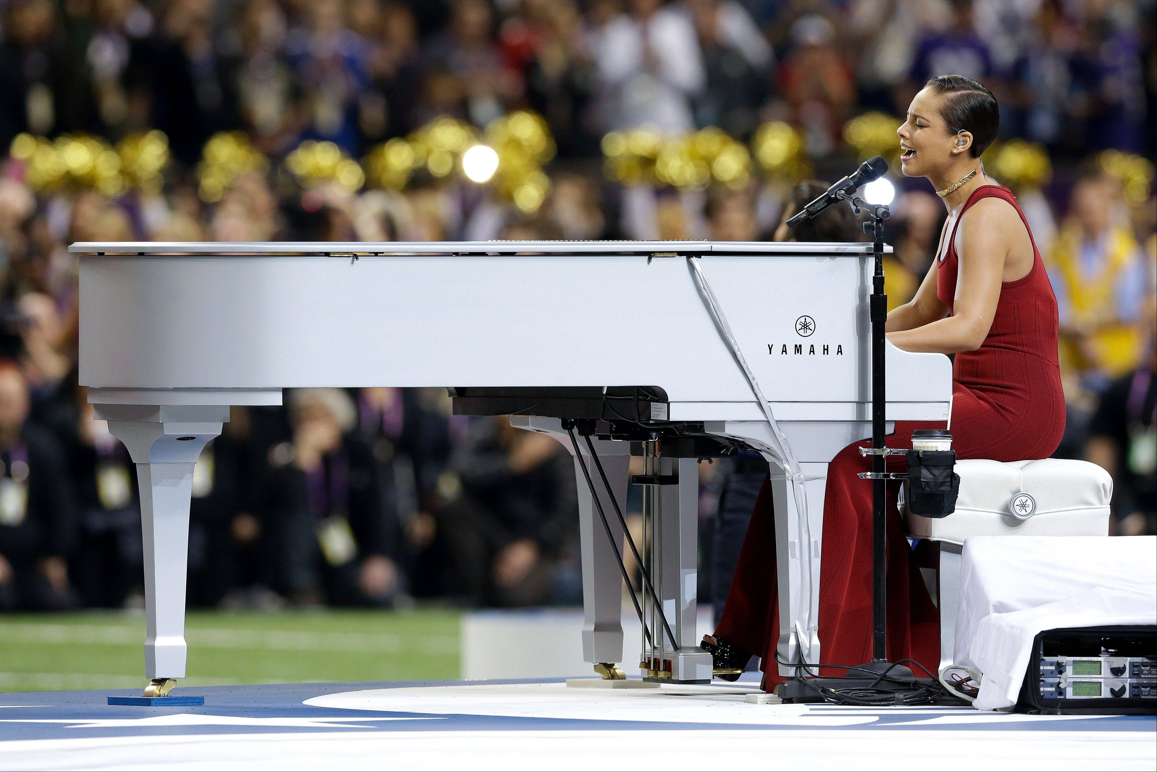 Alicia Keys delivers a stirring rendition of the national anthem before Super Bowl XLVII.