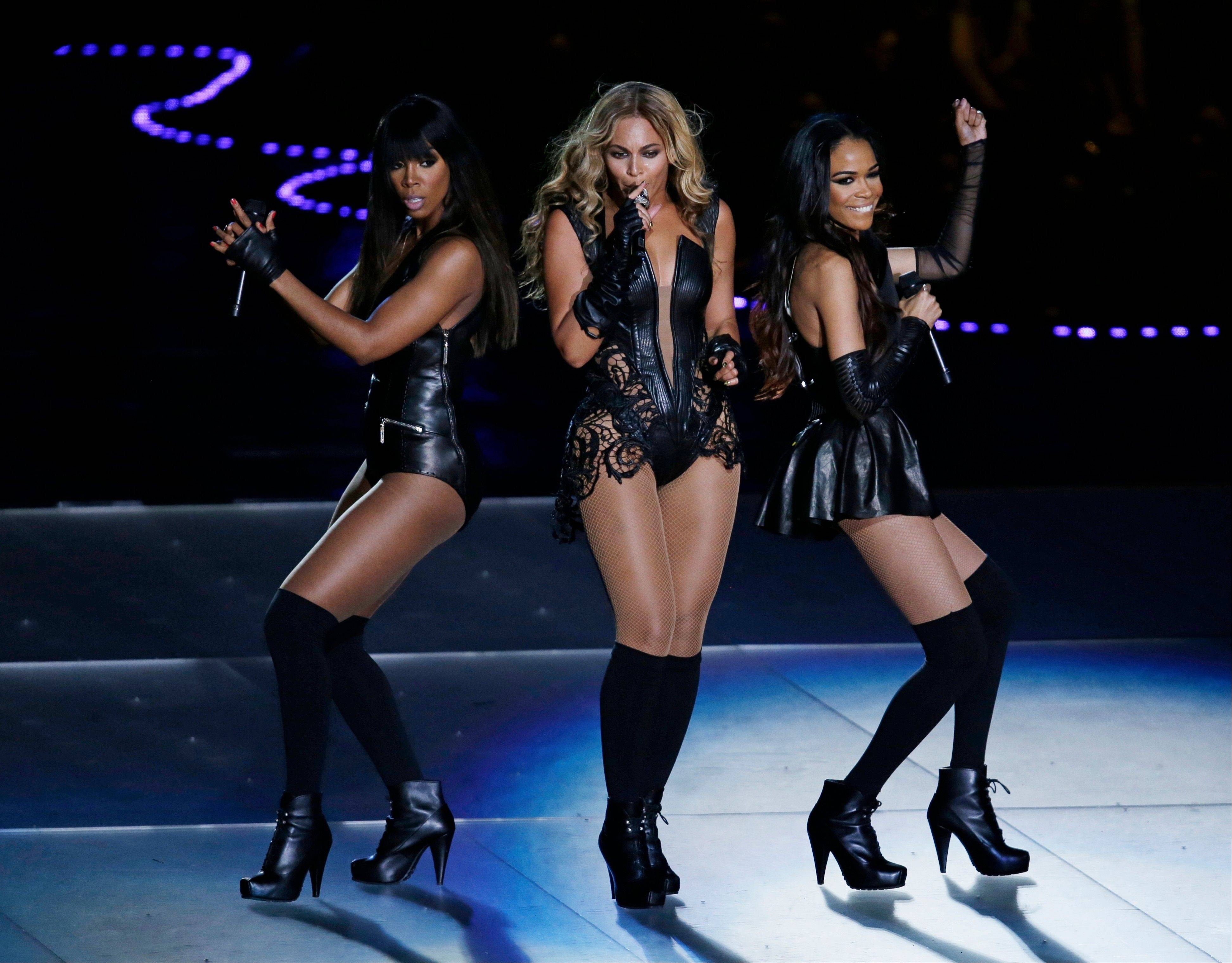 Beyonc� performs with Kelly Rowland, left, and Michelle Williams, right, of Destiny's Child, during the Super Bowl halftime show.