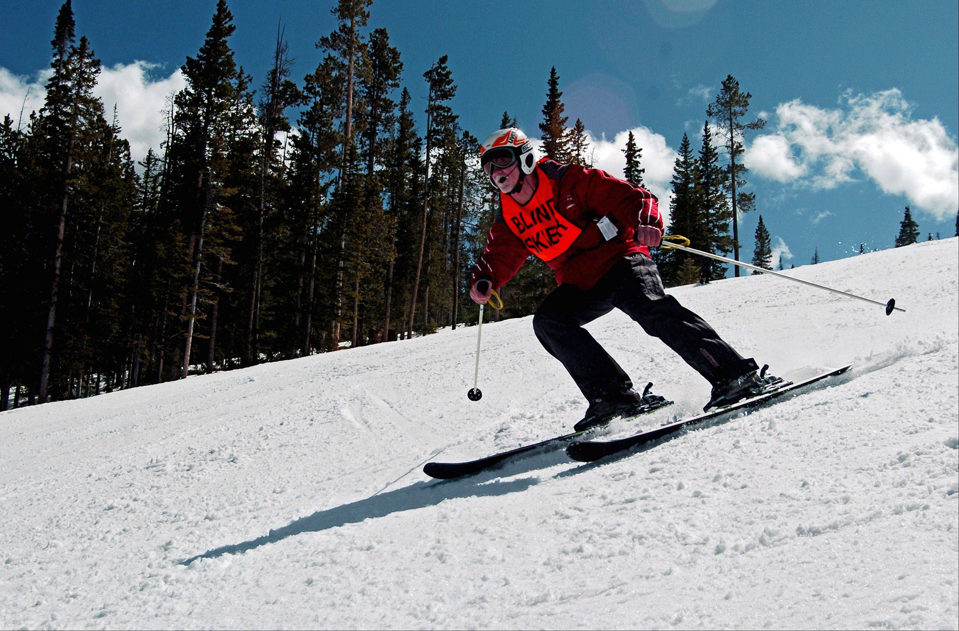 Blind skier Vic Gurganious cruises down a run at Colorado's Winter Park resort. Gurganious, a member of the alpine ski team at the National Ability Center in Park City, Utah, says he reaches speeds of up to 60 mph while communicating with his guide via a two-way radio built into his helmet.