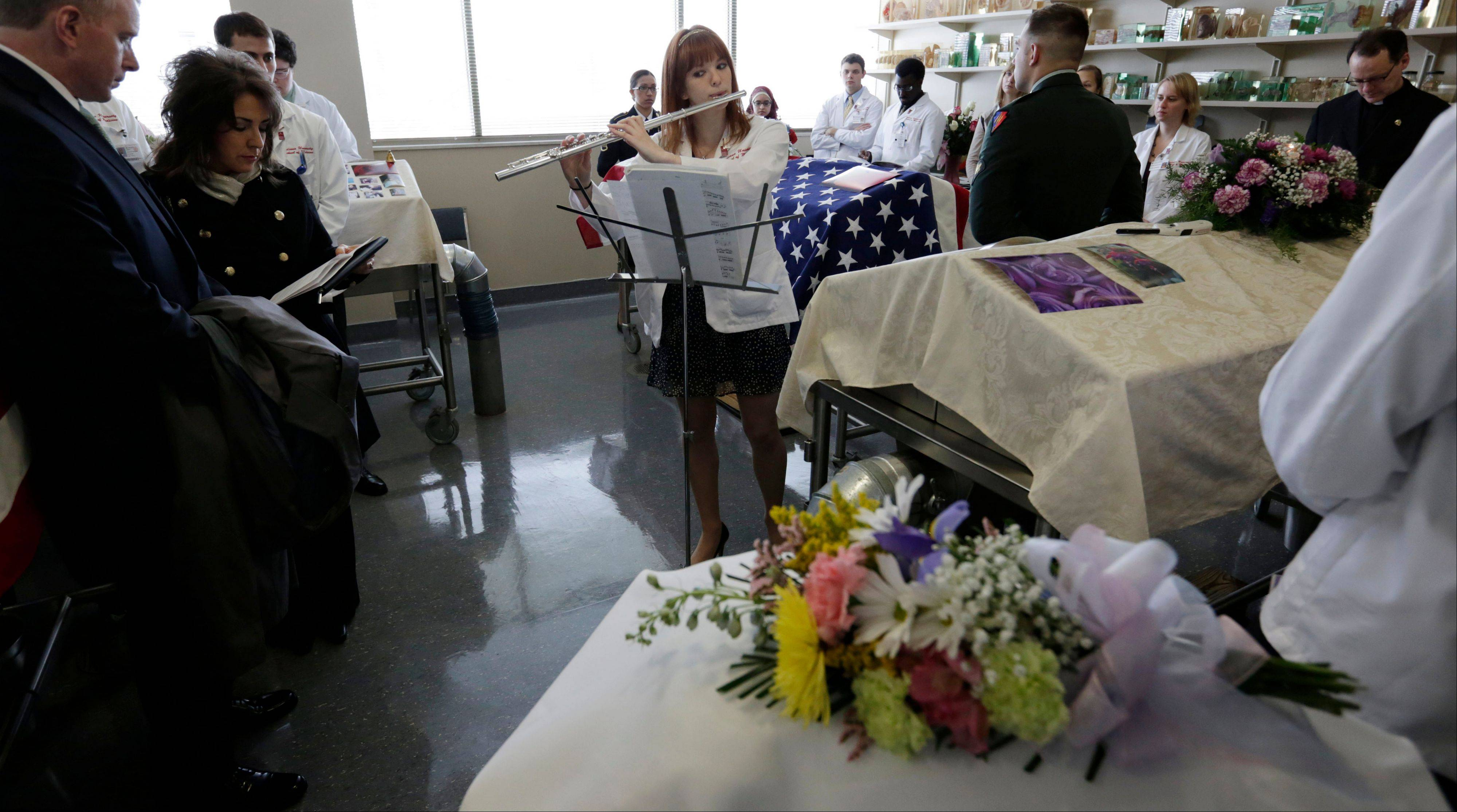 "Medical student Jennifer L. Peugh plays ""Concertino"" during a memorial service for bodies donated to science at Indiana University School of Medicine -- Northwest."