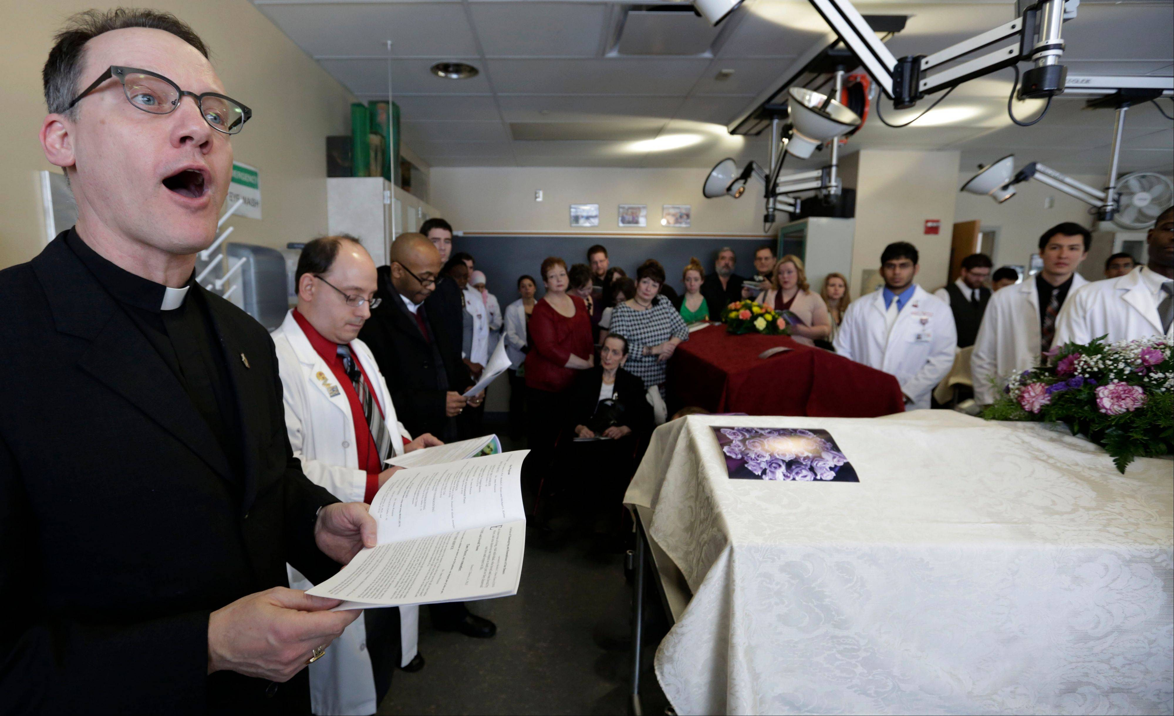Rev. James Wetzstein speaks during the hourlong memorial service, where relatives of the donors gather around the steel tables where their loved ones were dissected with the medical students who worked on the bodies during the previous semester. The students read letters of appreciation, clergy offer prayers, and tears are shed.