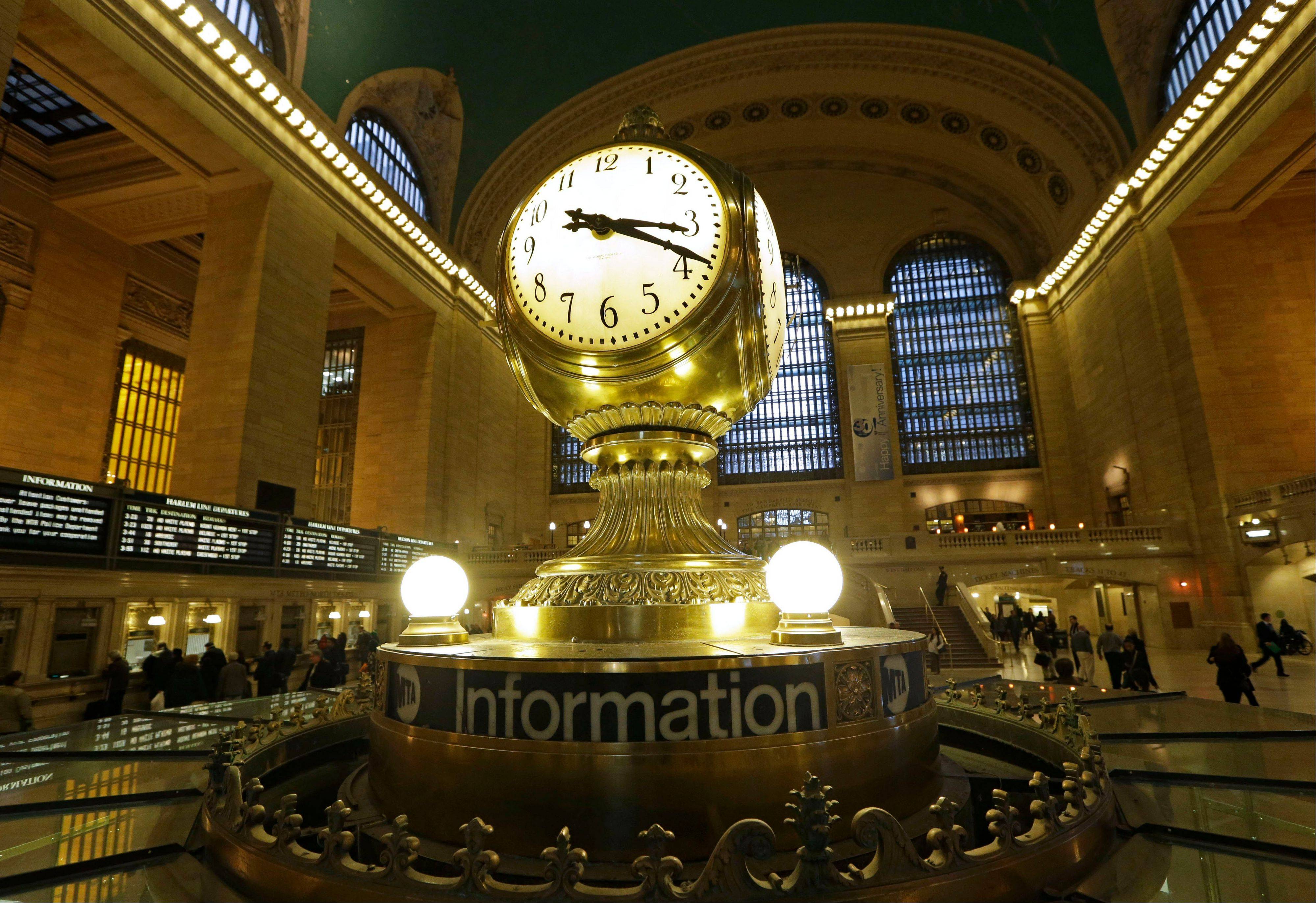 The famous opalescent clock keeps time at the center of the main concourse in Grand Central Terminal.
